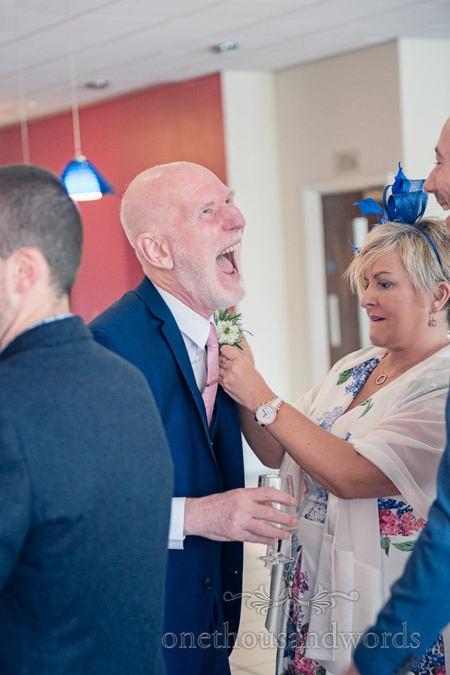 Father of the bride laughs at Italian Villa wedding photographs