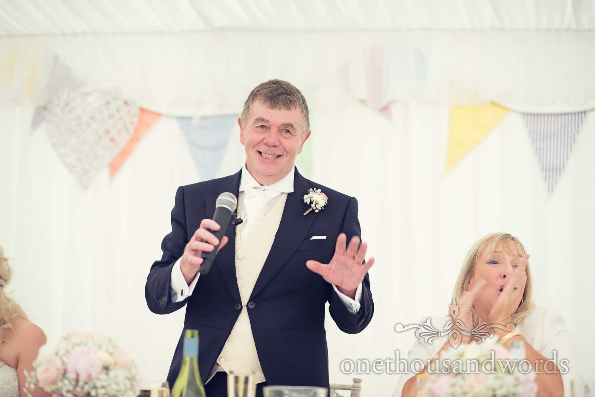 Father of the bride speech with bunting at Deans Court Wedding