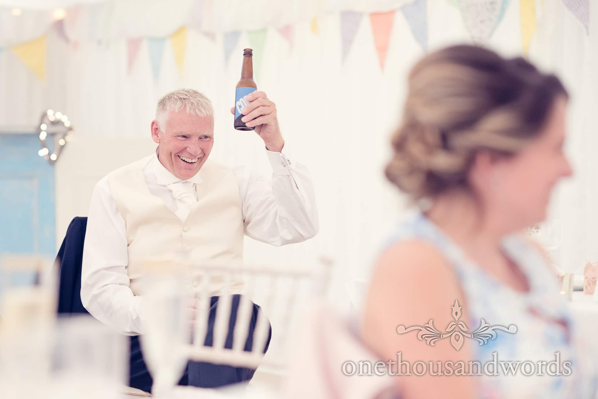 Father of the groom toasts speeches with a beer bottle at Deans Court wedding