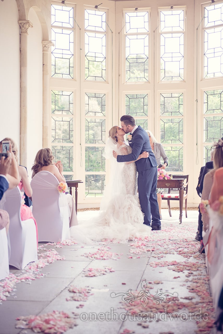 First kiss at Highcliffe castle photographs by one thousand words wedding photographers