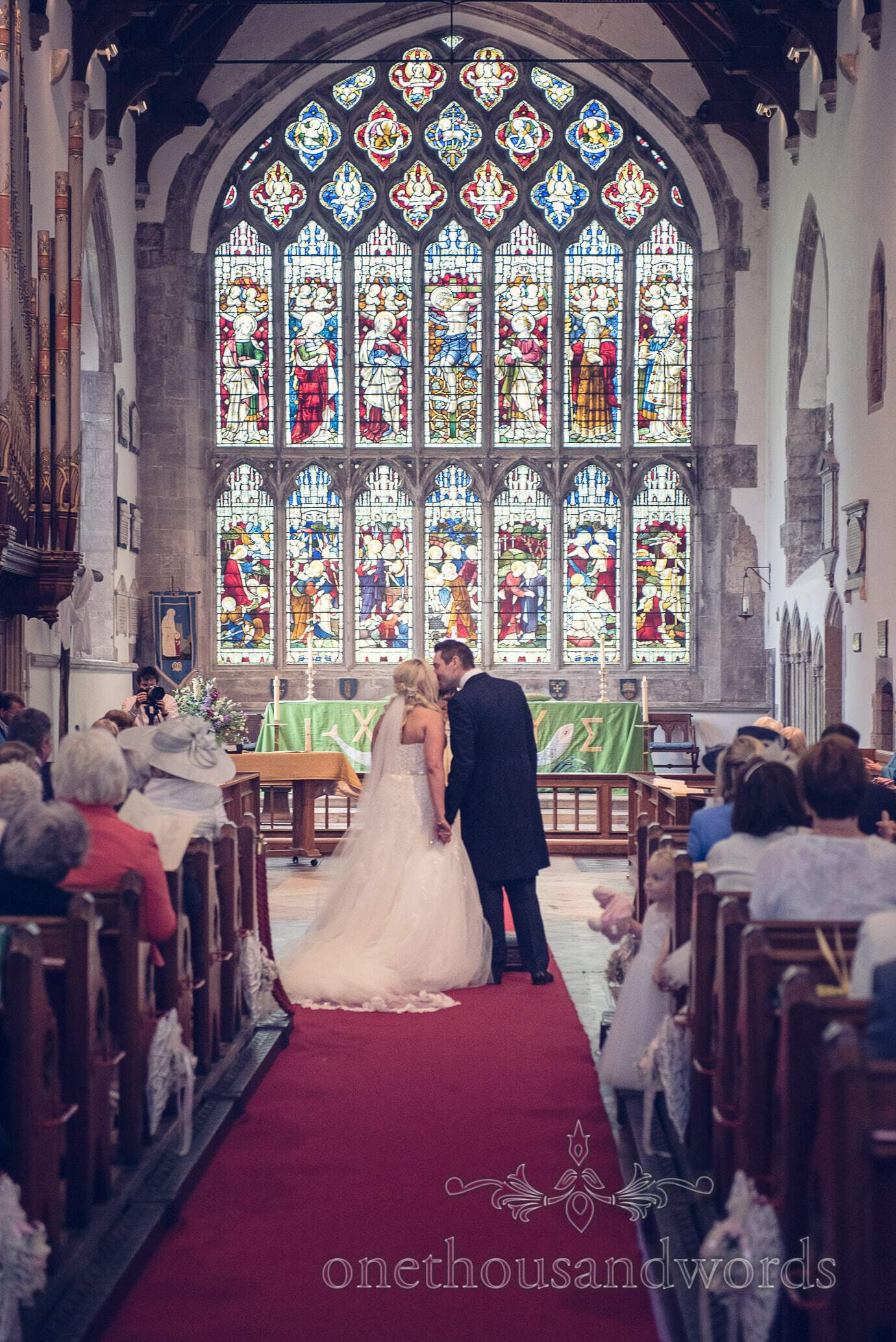 First kiss at St Marys church wedding in Wareham, Dorset