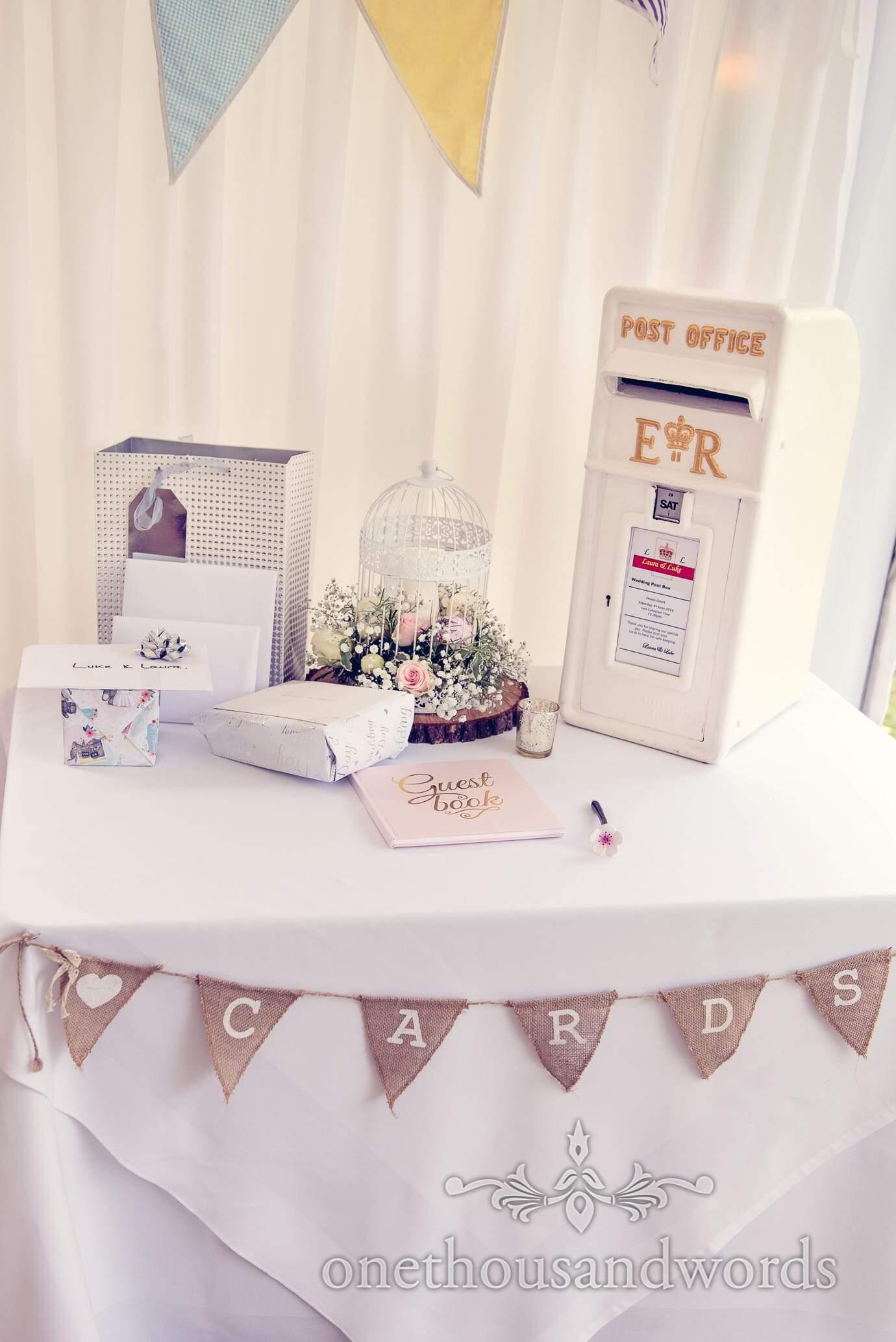 Flower birdcage, bunting, guest book and white postbox at Deans Court wedding