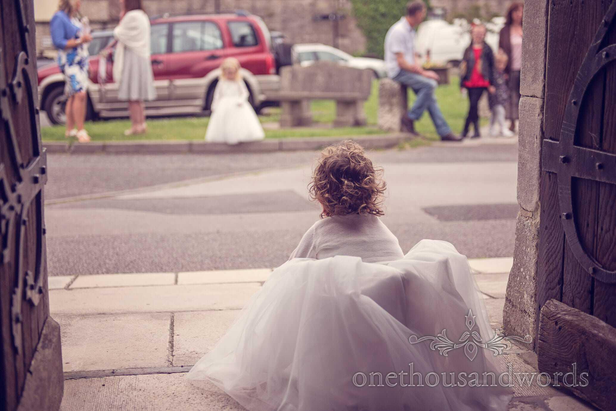 Flower girls looks for bride at Wareham Church wedding