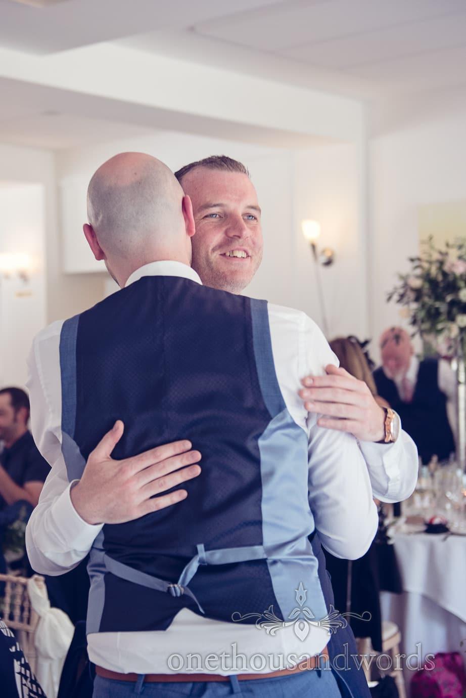 Groom and best man embrace at Italian Villa Wedding Photographs