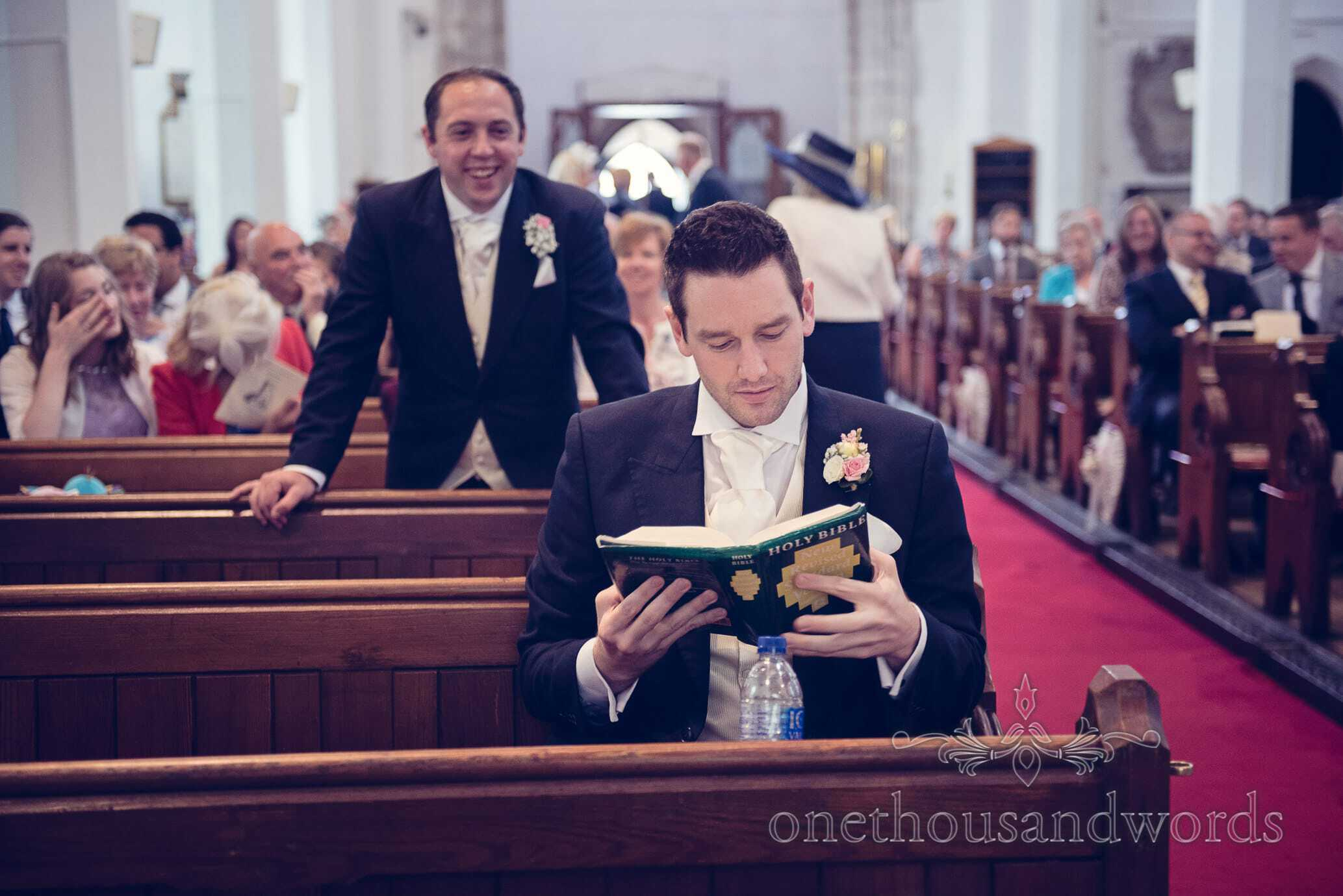 Groom reads Holy Bible before church wedding ceremony in Dorset Church