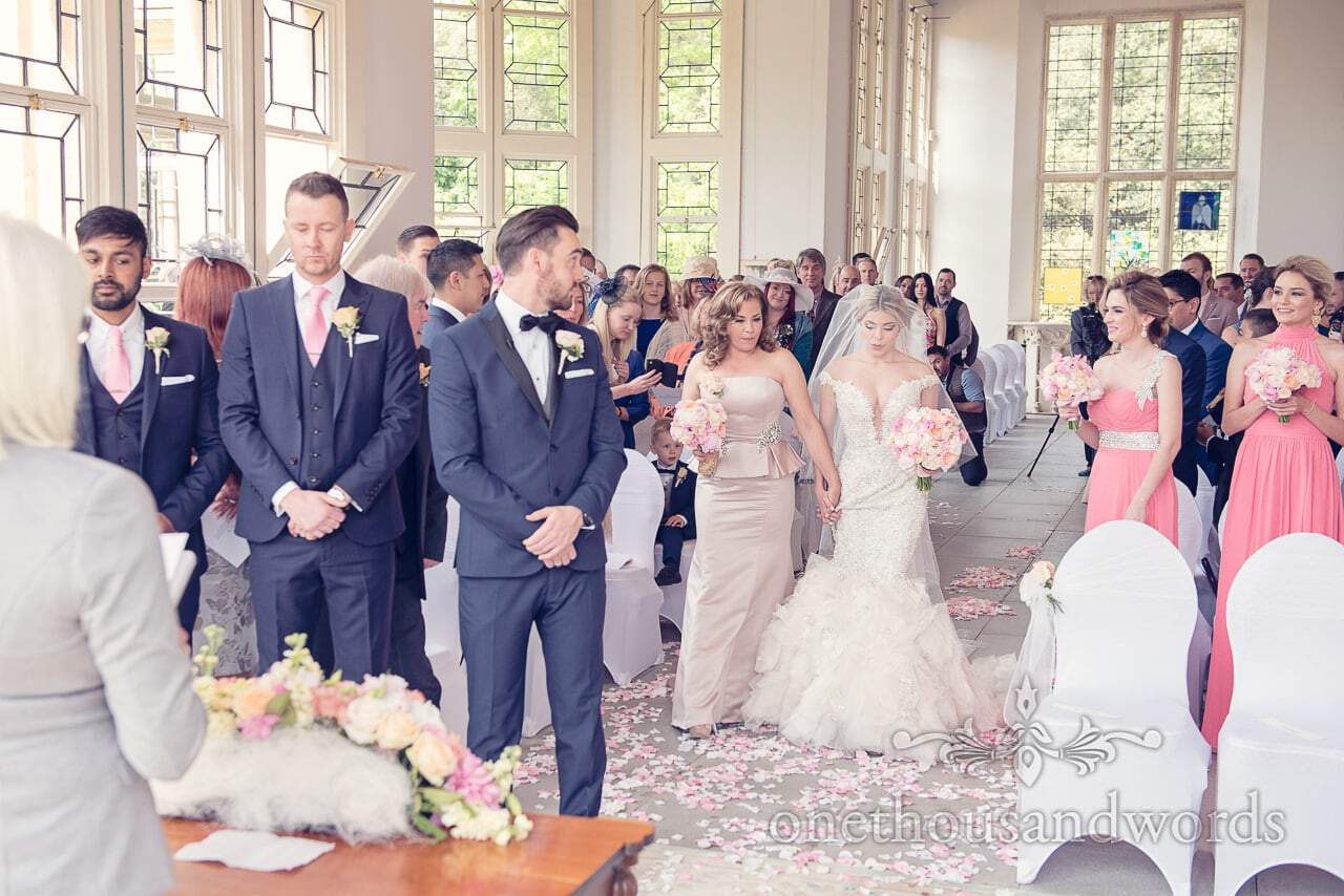 Groom sees bride at Highcliffe Castle wedding