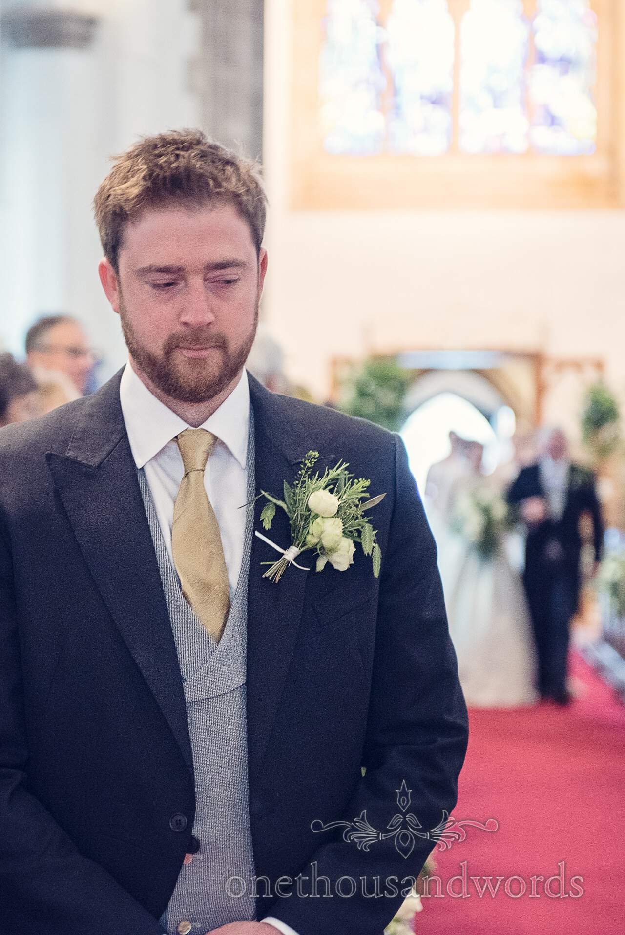 Groom waits for bride to come down the aisle at St Mary's Church Wareham