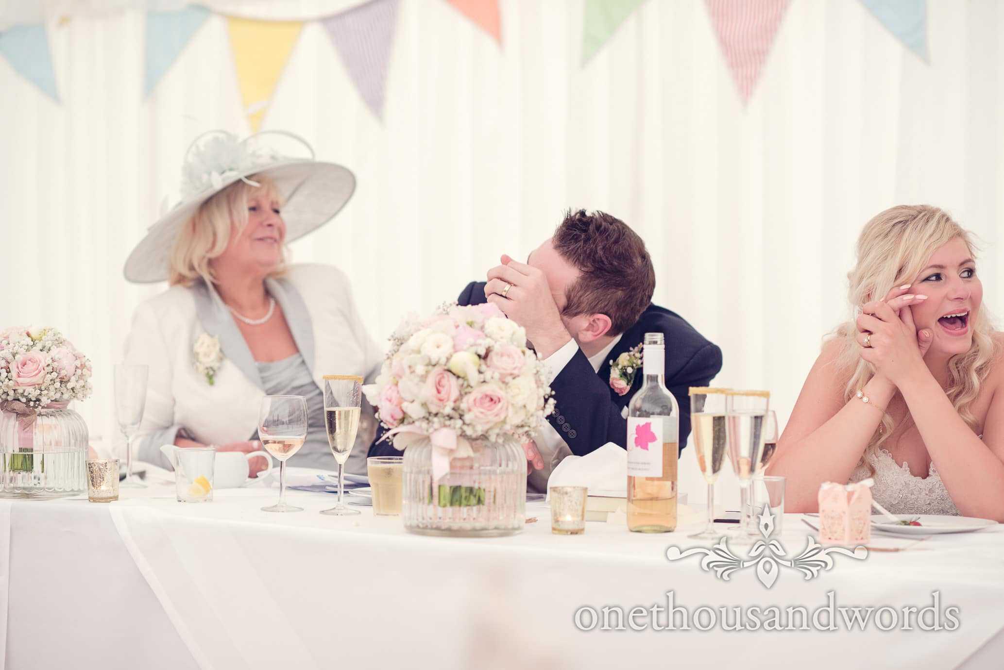 Grooms reaction to best mans speech at Deans Court Wedding