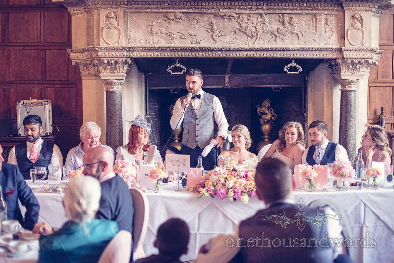 Grooms Speech in front of fireplace at Rhinefield House Wedding photographs