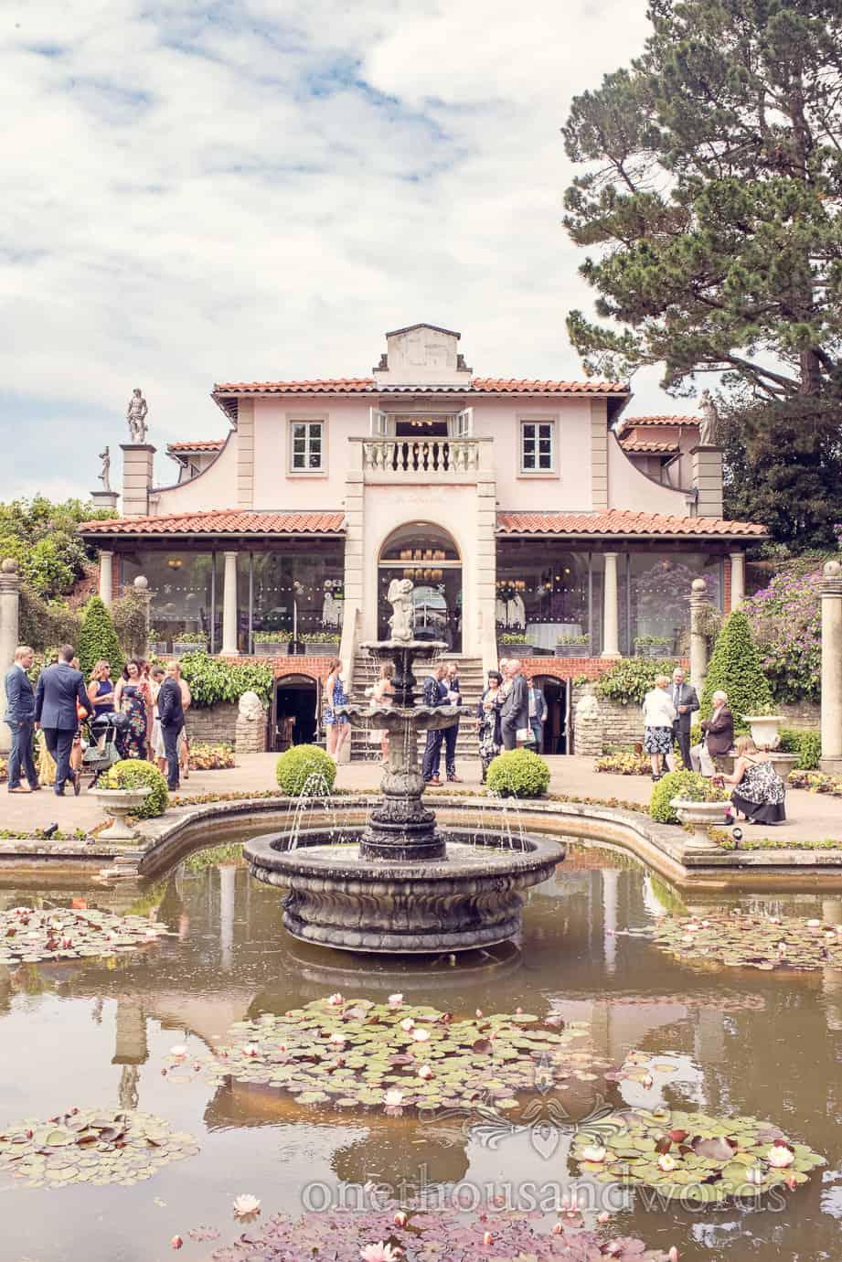 Guests gather in garden before Italian Villa Wedding Photographs