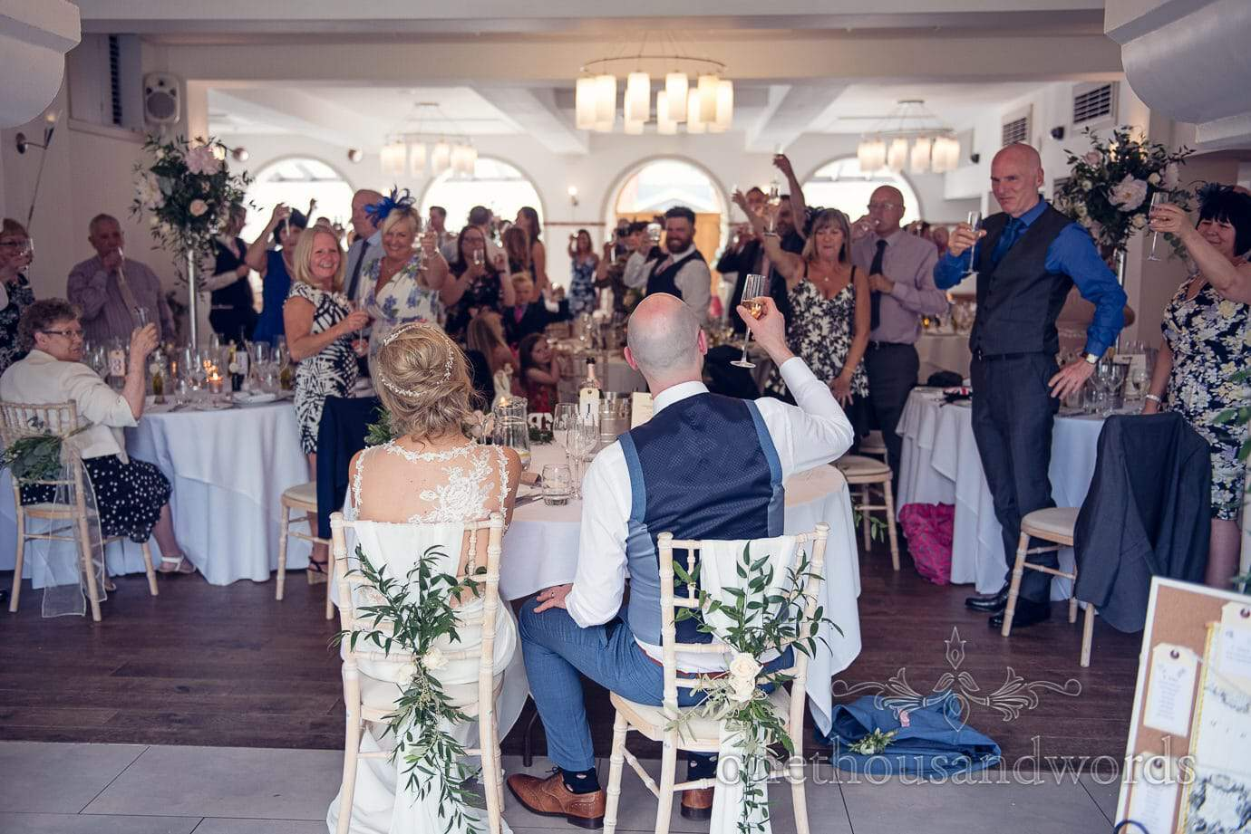 Guests toast the bride and groom at Italian Villa Wedding Photographs