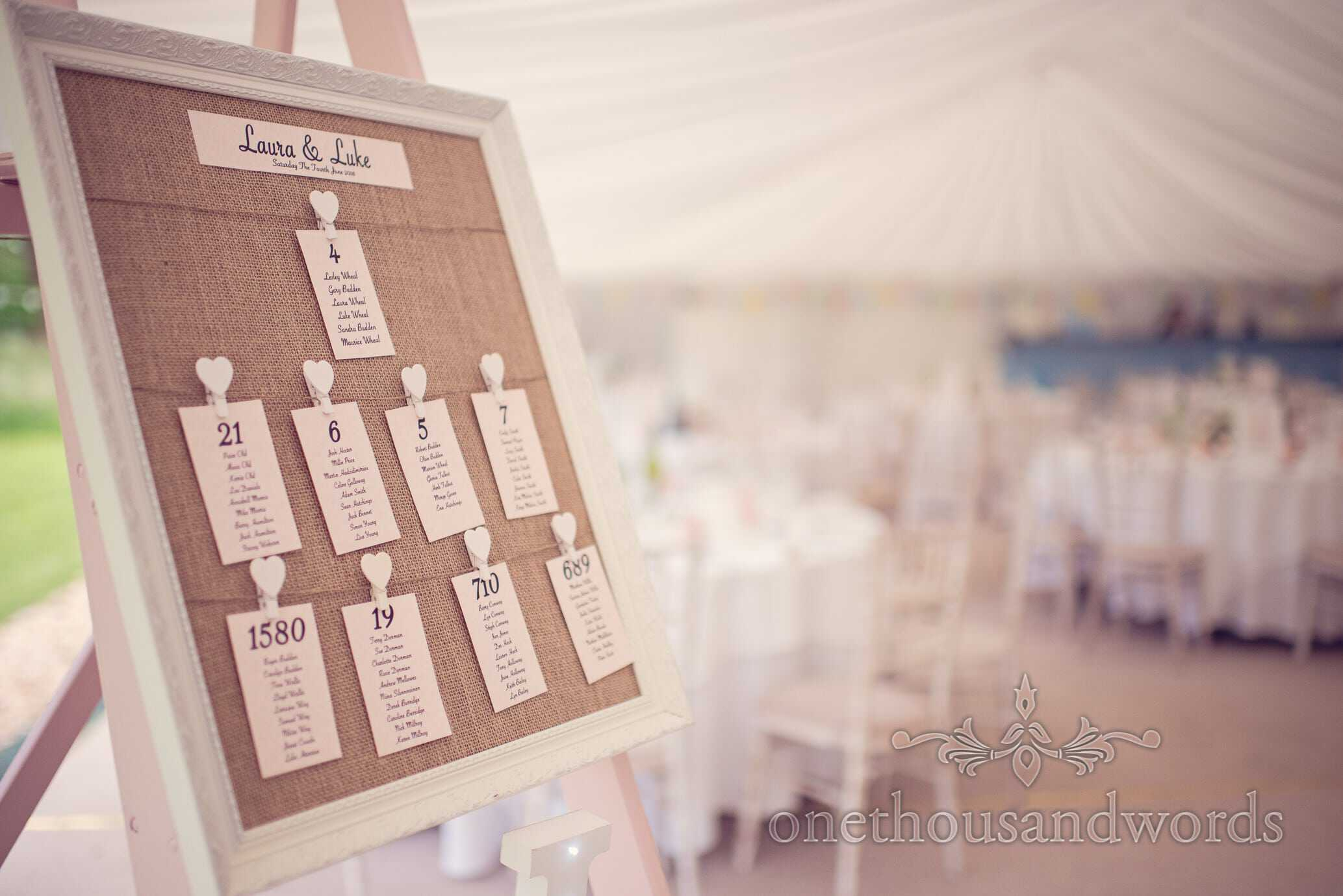Hessian peg board picture frame table plan at Deans Court wedding
