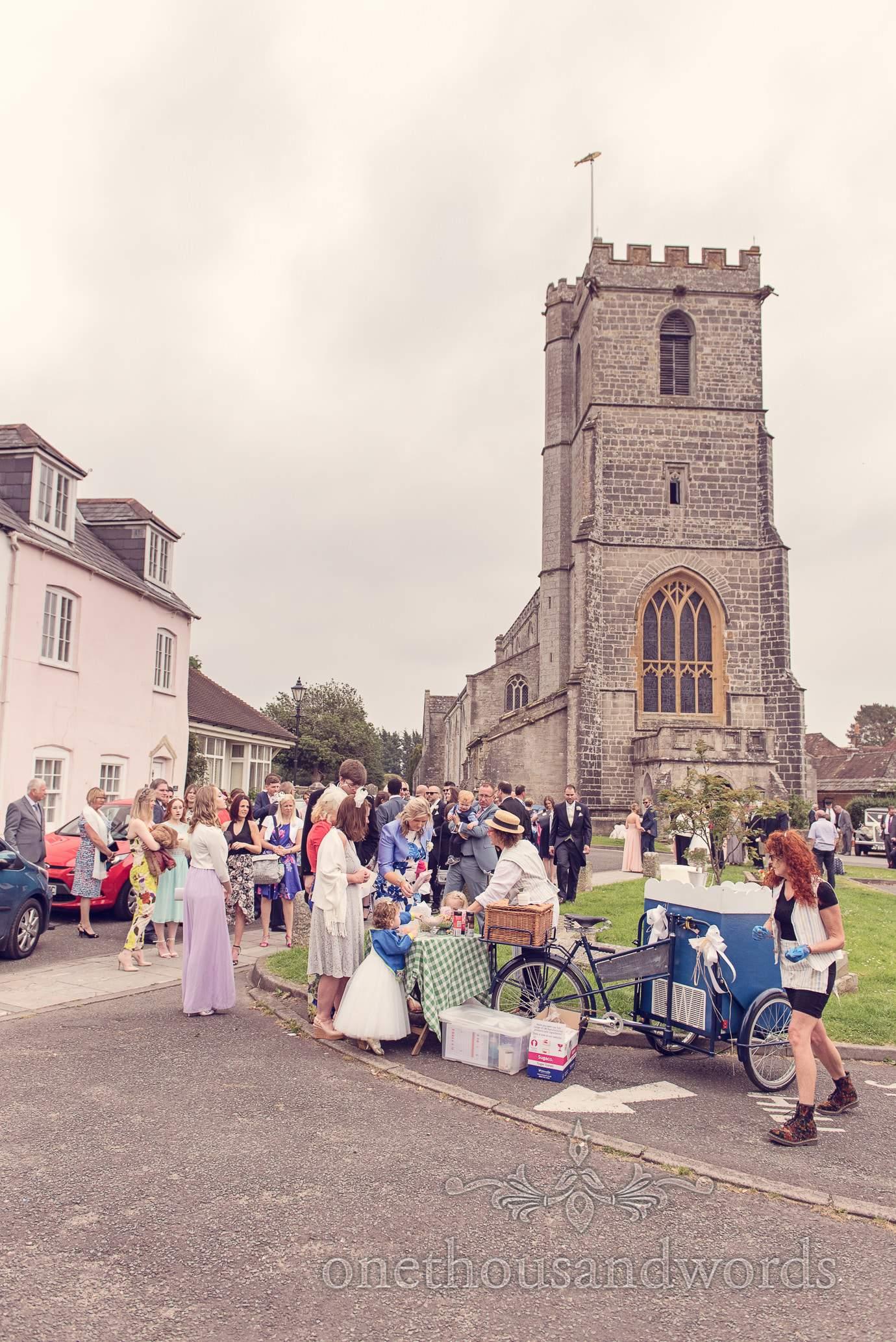 Ice cream tricycle outside St Marys Church wedding in Wareham, Dorset