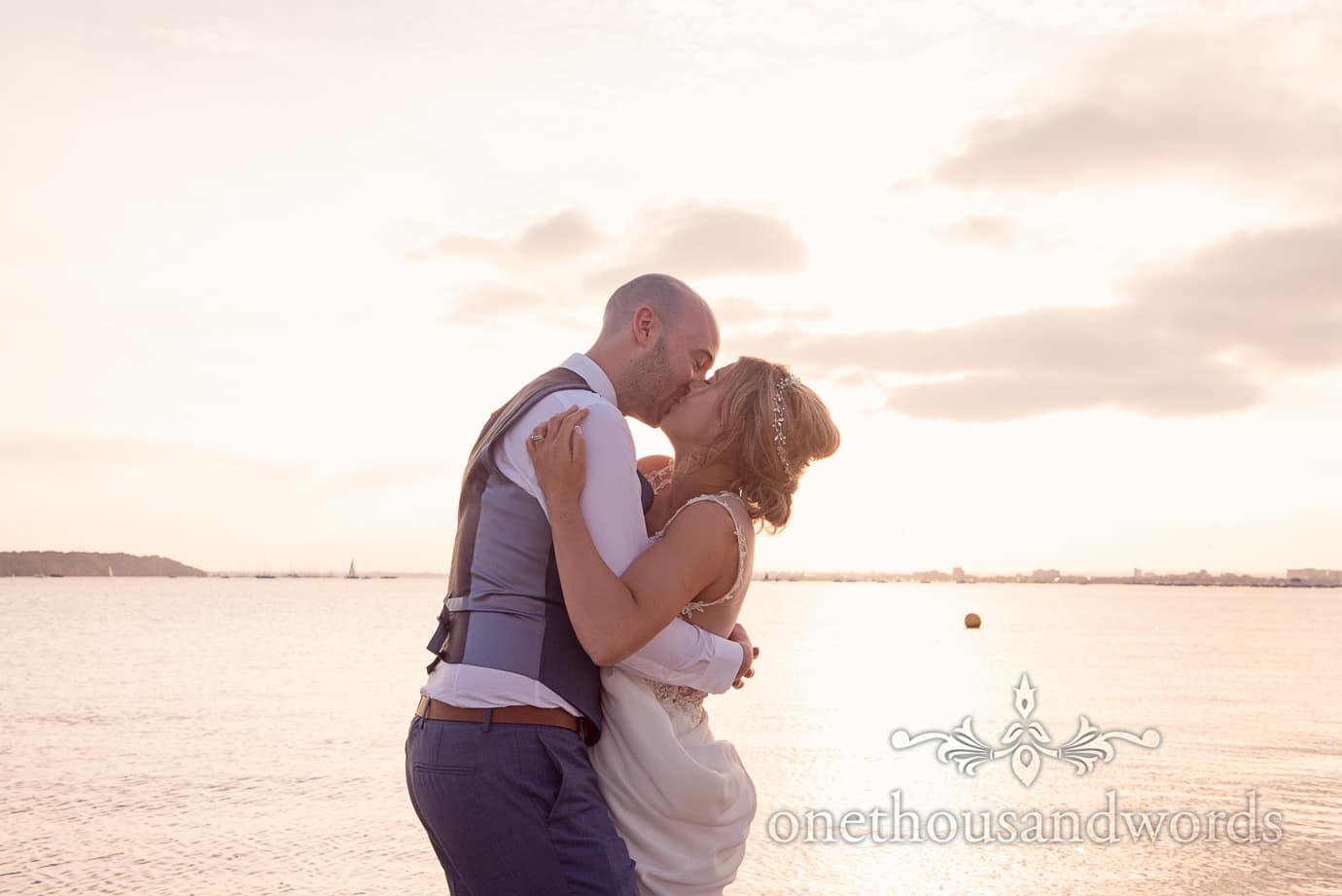Kiss on the beach at Italian Villa Wedding Photographs