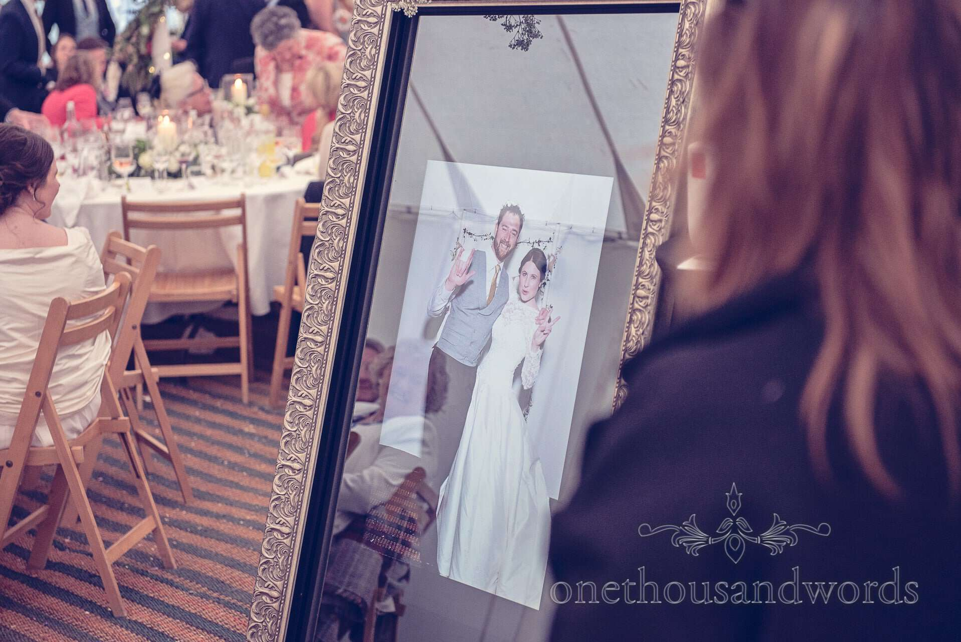 Magic mirror photo booth with bride and groom at wedding