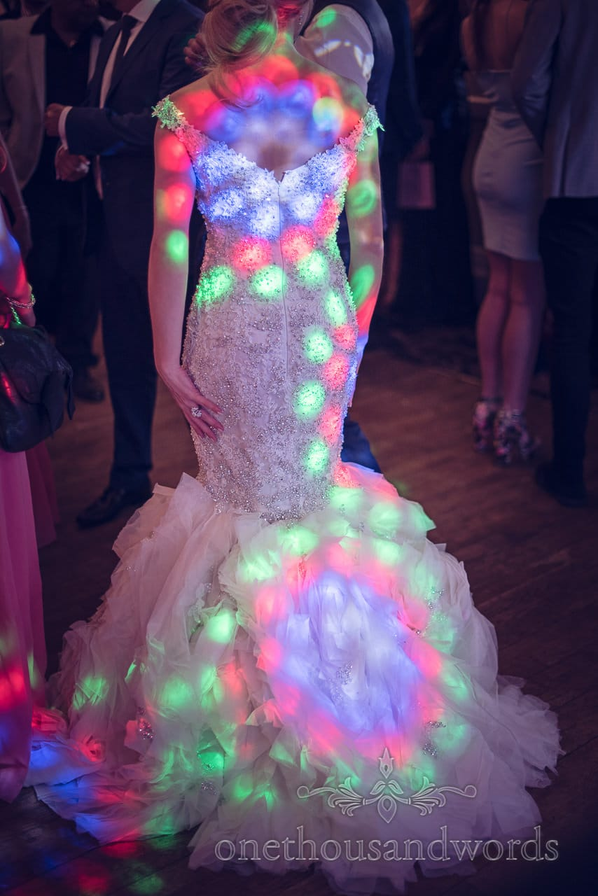 Mermaid Wedding dress lit with multicolour disco lights at Rhinefield House Wedding