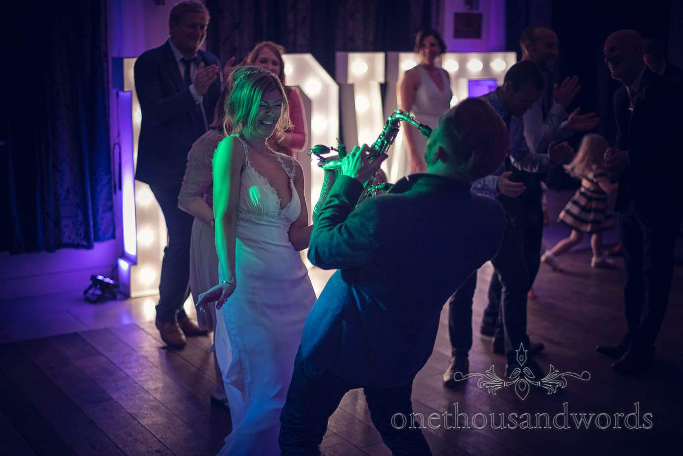 Musician plays to the bride from Italian Villa Wedding Photographs