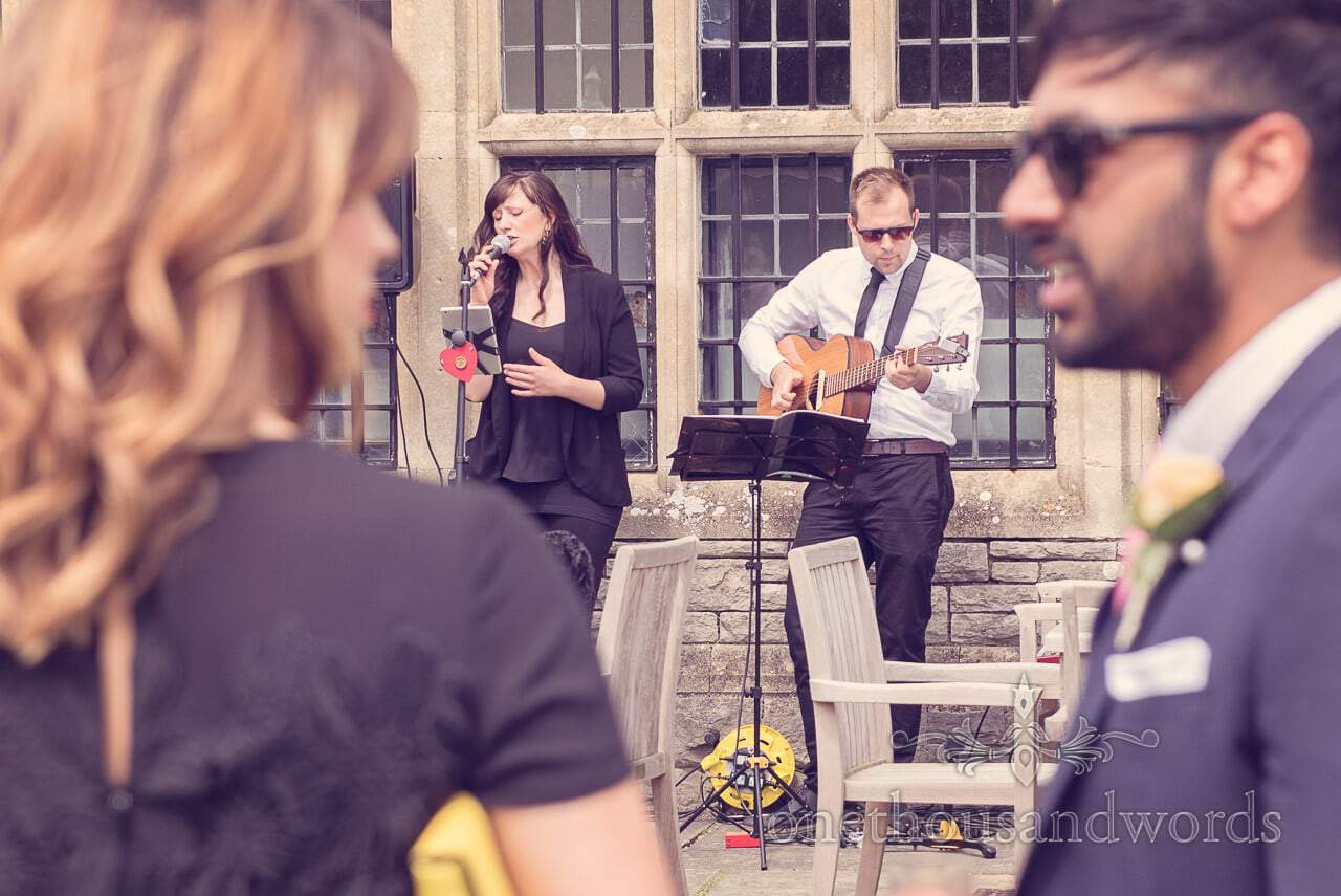 Musicians outside in sun at Rhinefield House Wedding