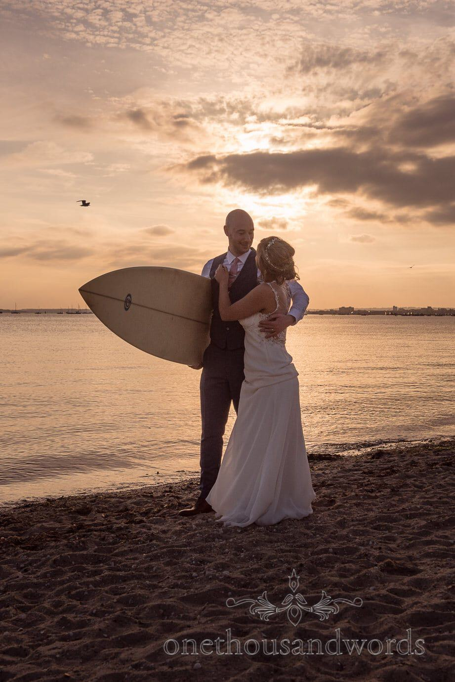 Newlyweds with surfboard from Italian Villa Wedding Photographs