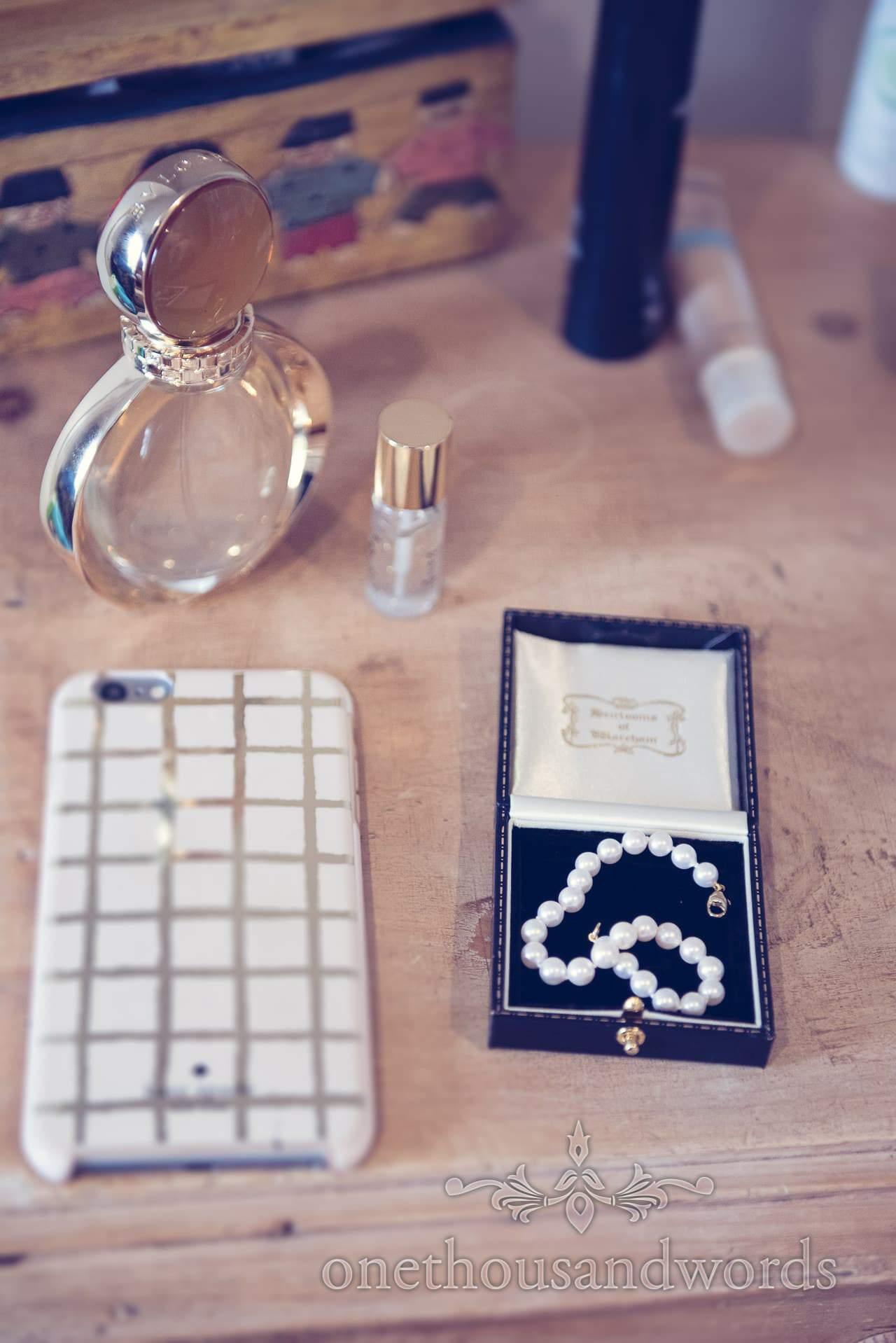 Pearl bracelet wedding gift with wedding perfume