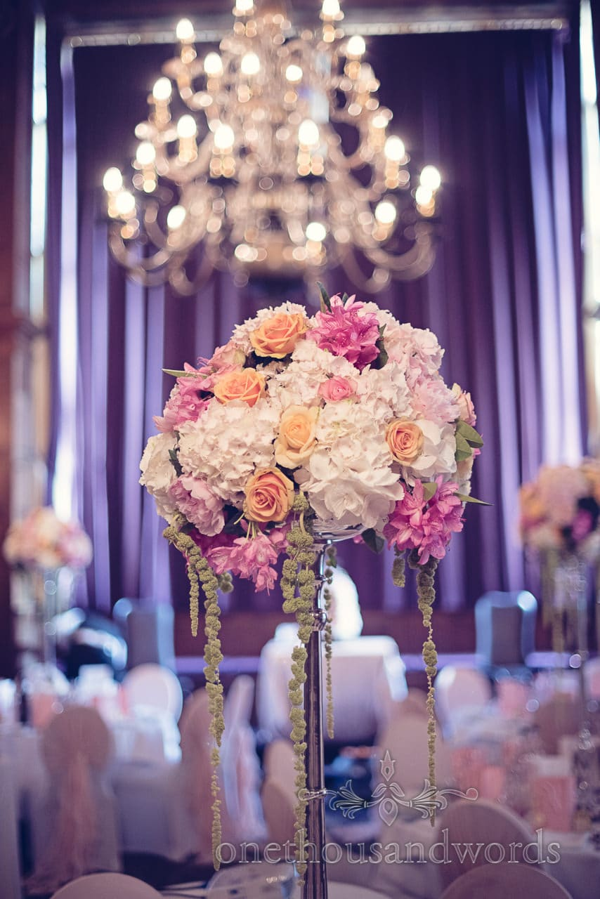 Tall floral table centerpiece at Rhinefield House Wedding