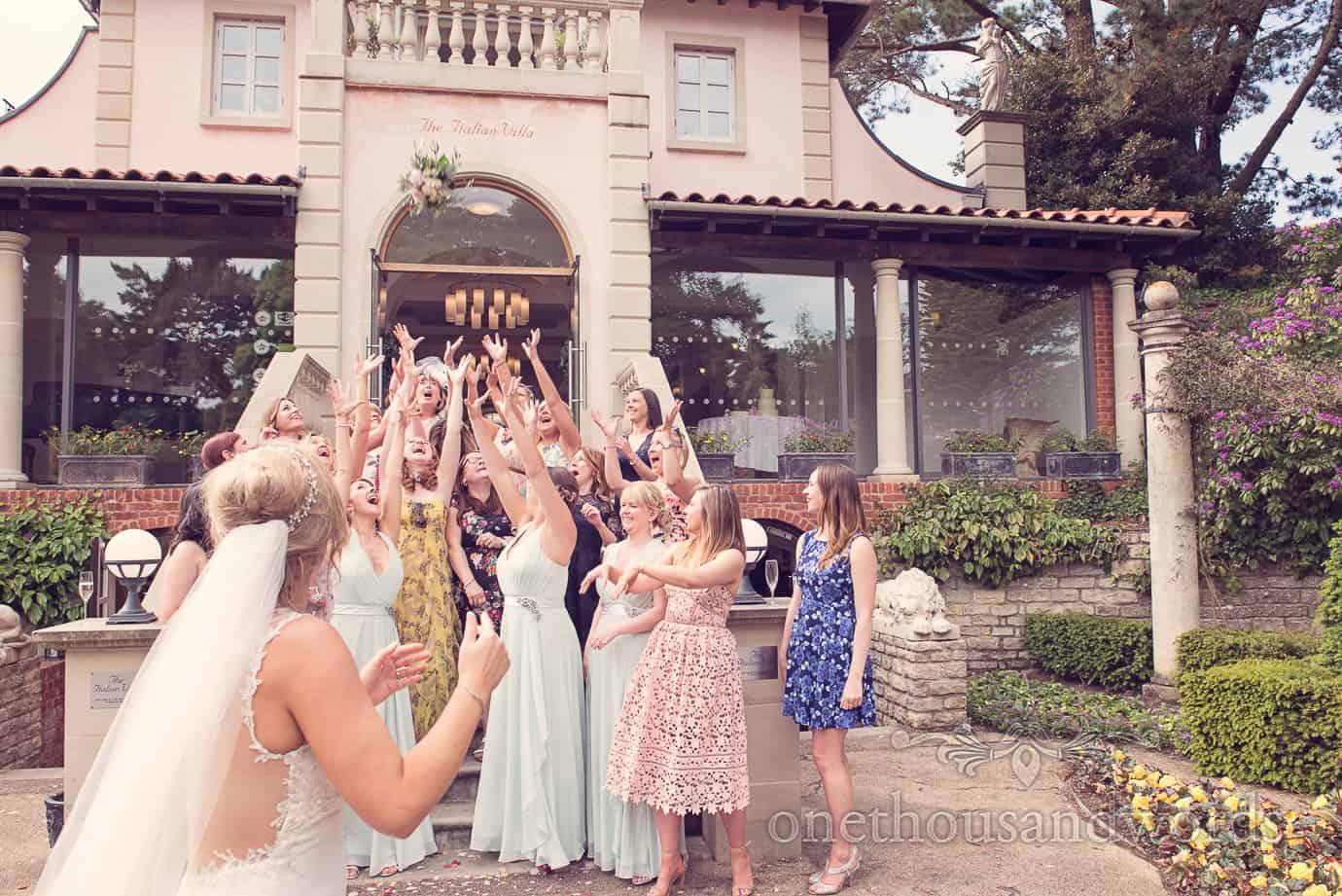 Throwing the bouquet at Italian Villa Wedding Photographs