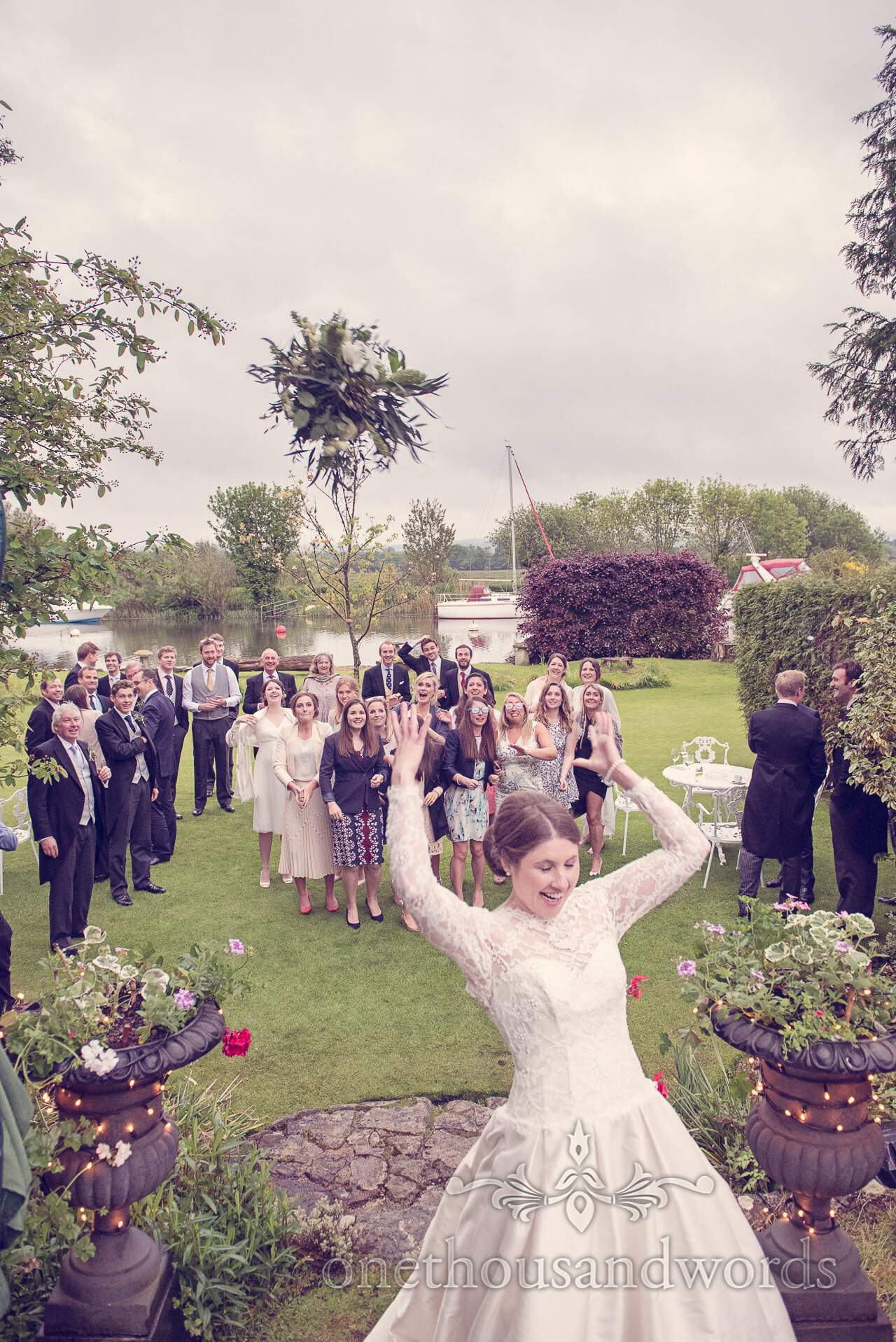 Throwing the bouquet next to Wareham River at The Priory Wareham wedding