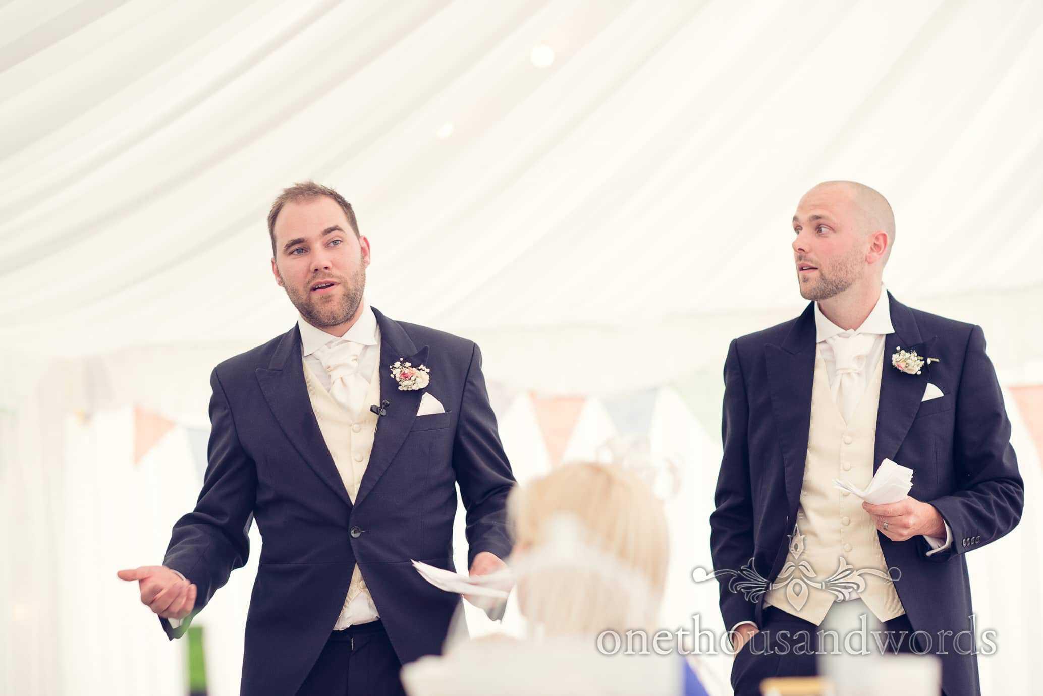 Two best men make best mans speeches at Deans Court wedding marquee