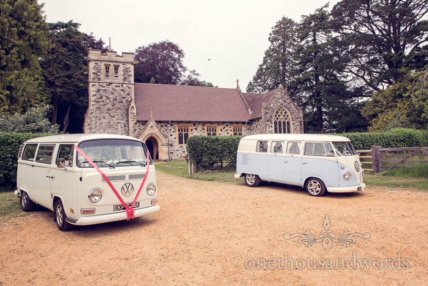 VW wedding camper vans with wedding ribbons at Dorset Church wedding