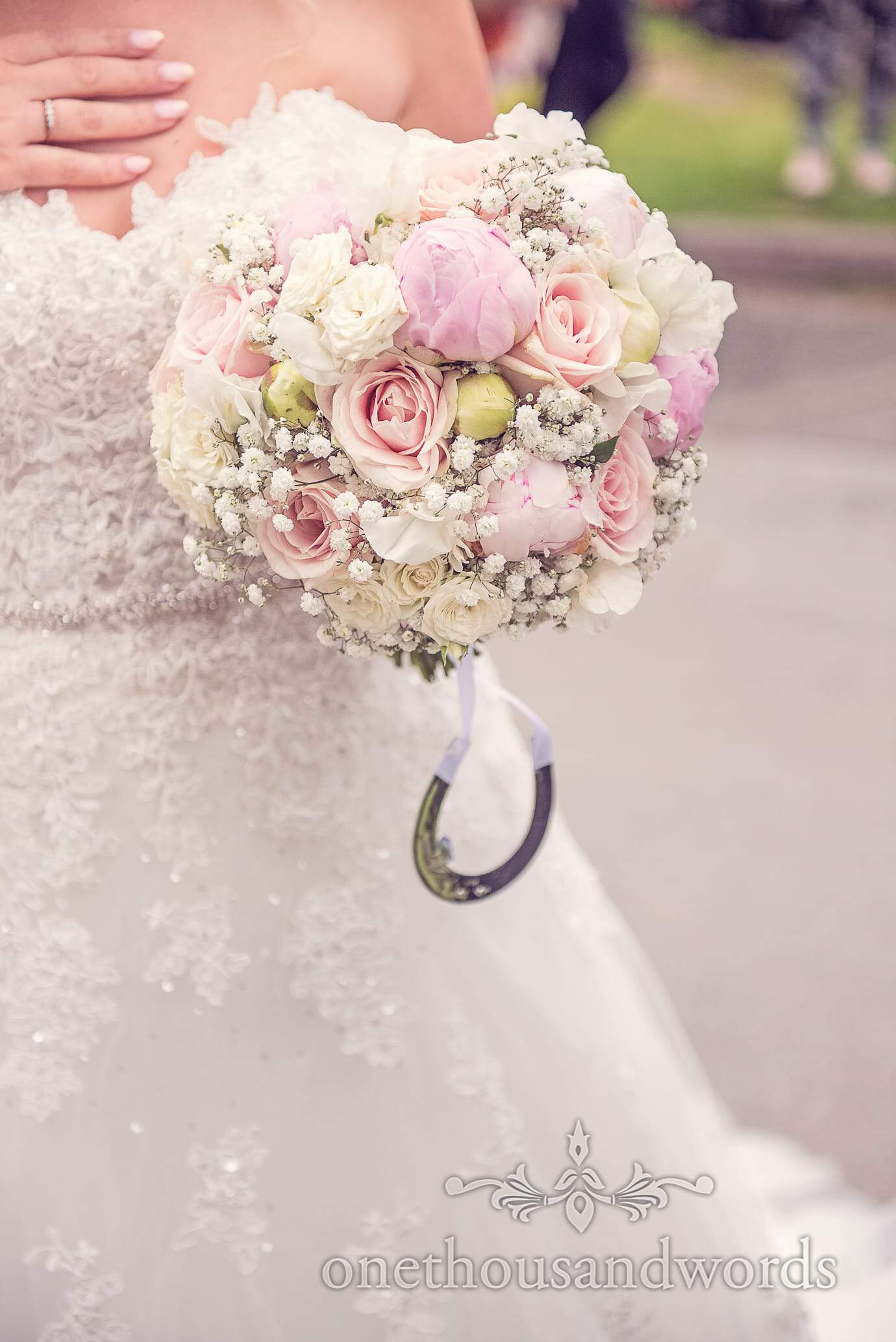 Wedding bouquet with pink and pastel flowers by Concept Flowers
