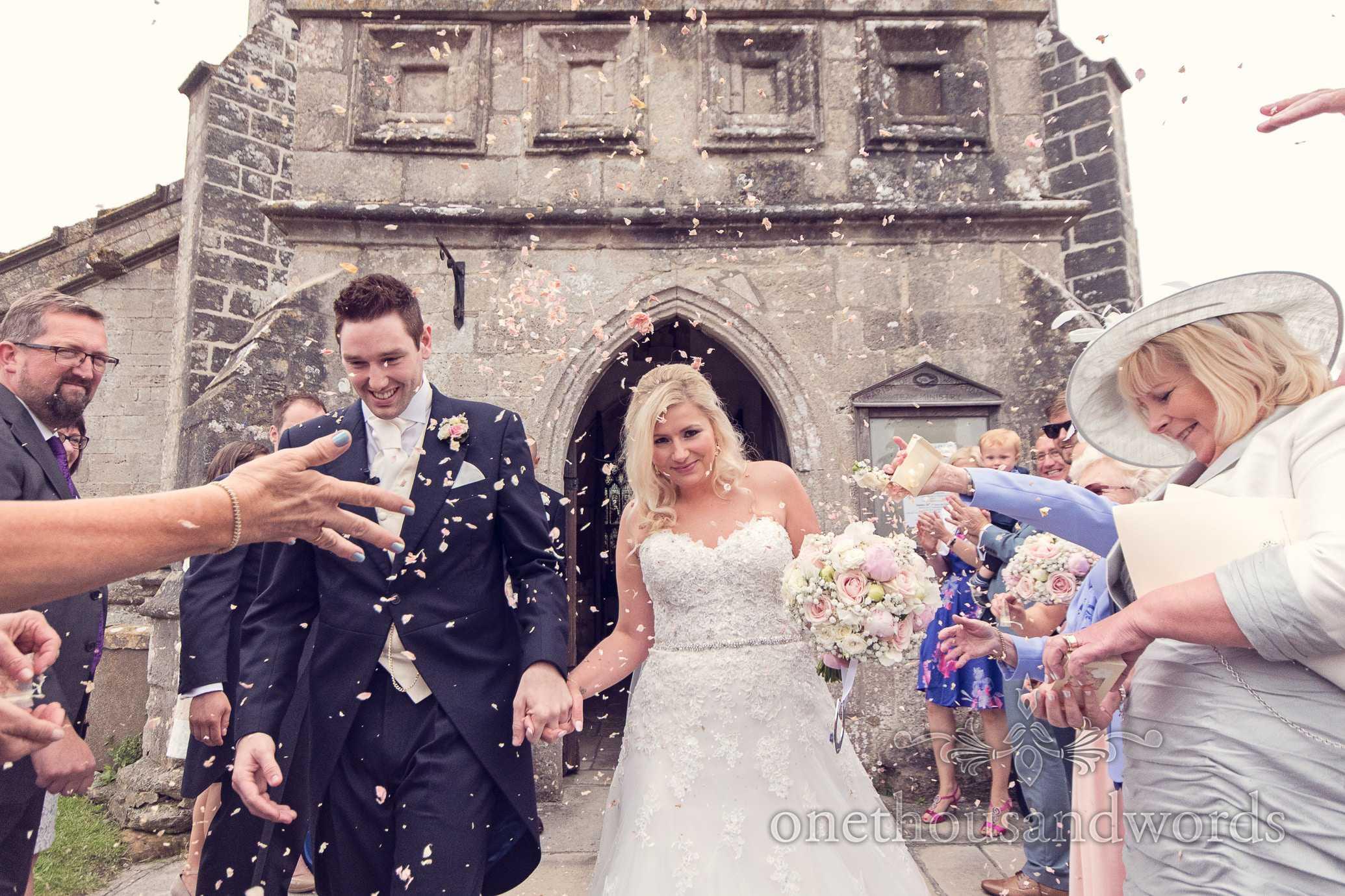 Wedding confetti outside St Marys Church wedding in Wareham, Dorset