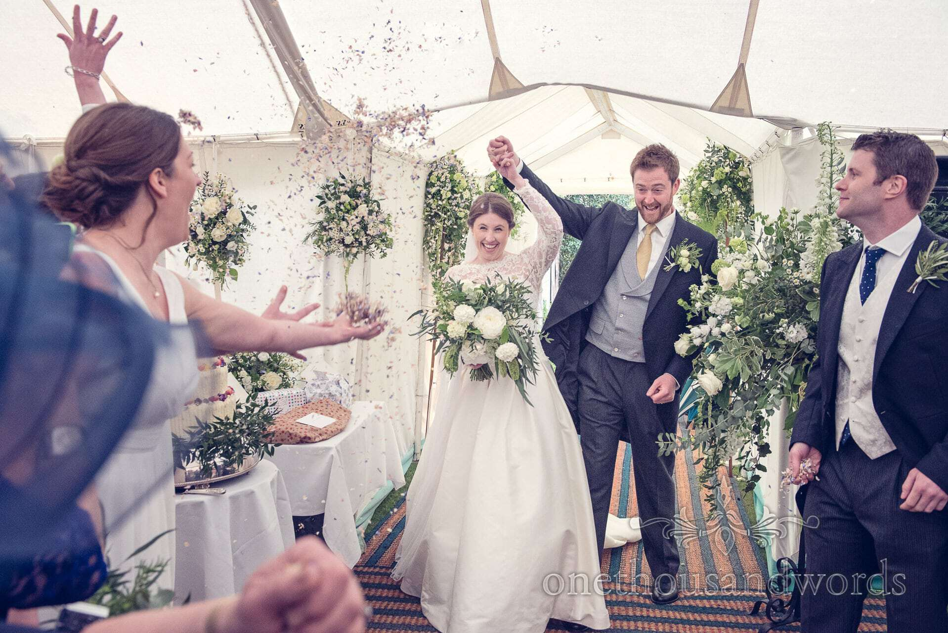 Wedding confetti with bride and groom in marquee