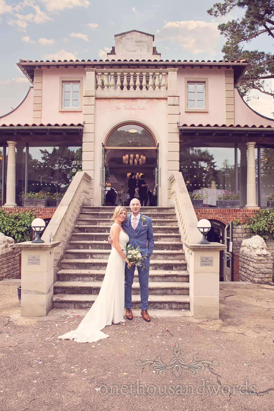 Wedding couple at bottom of stairs at Italian Villa wedding photographs