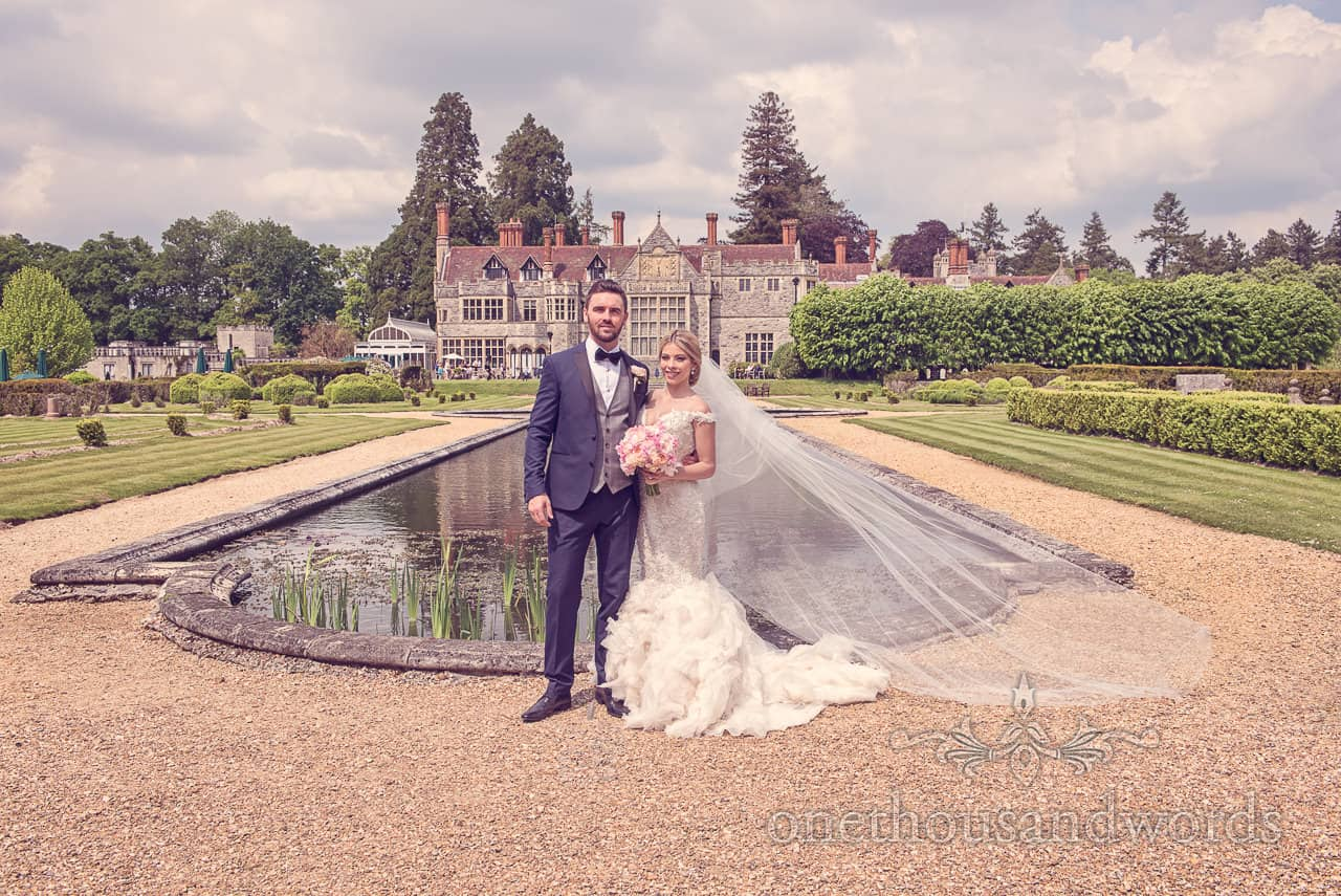 Wedding couple in front of Koi pond at Rhinefield House Wedding