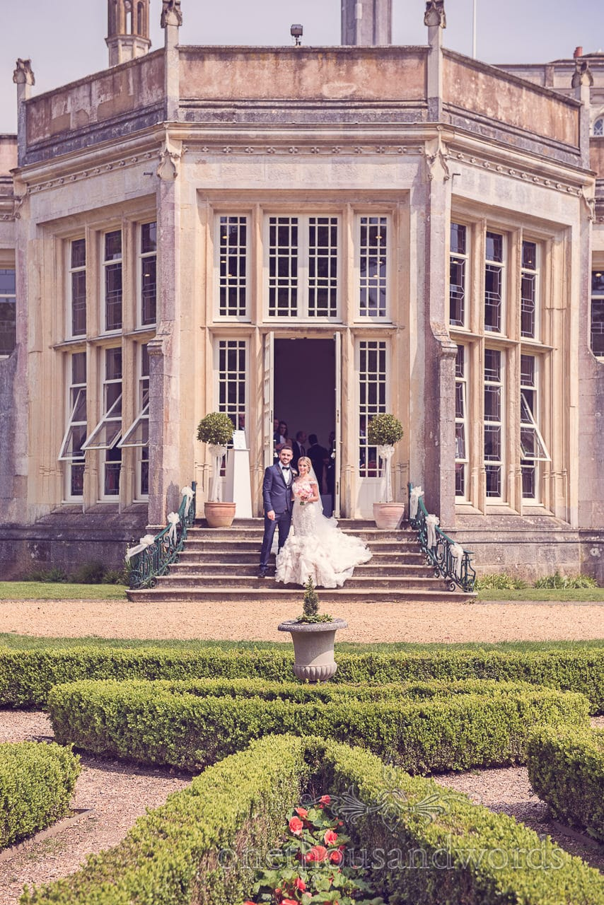 Wedding couple in sun at Highcliffe castle wedding