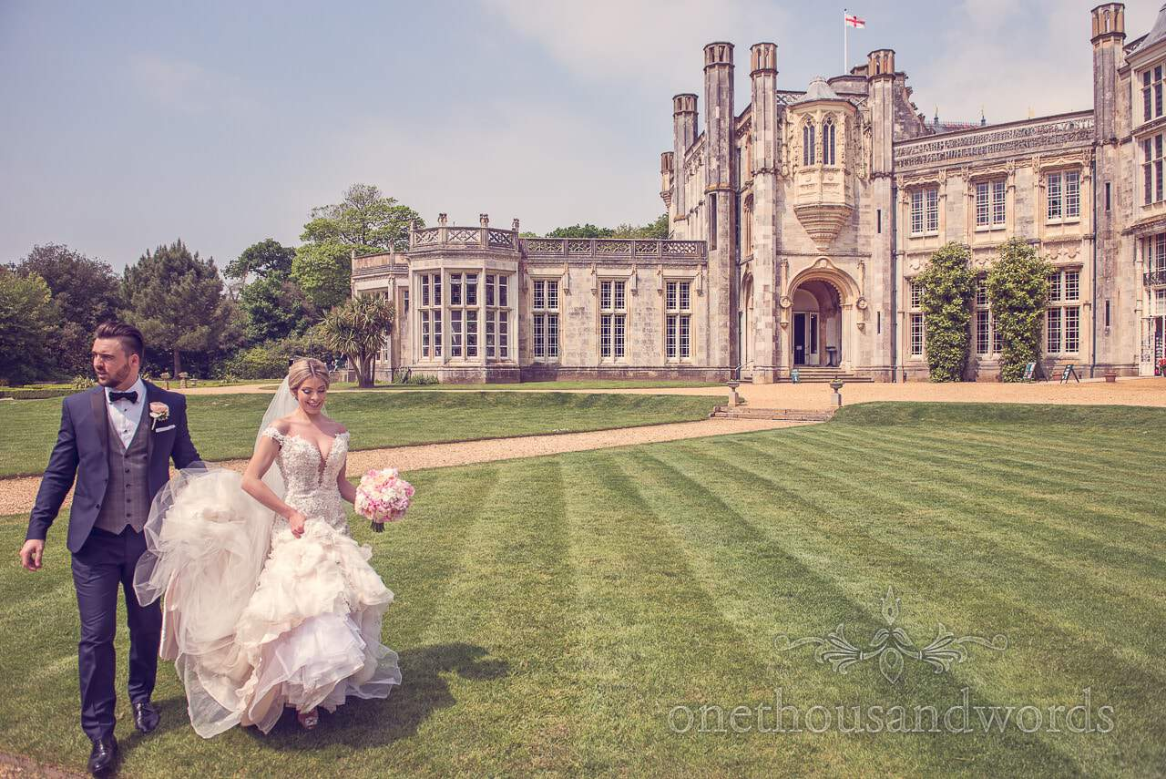 Wedding couple on lawn at Highcliffe castle