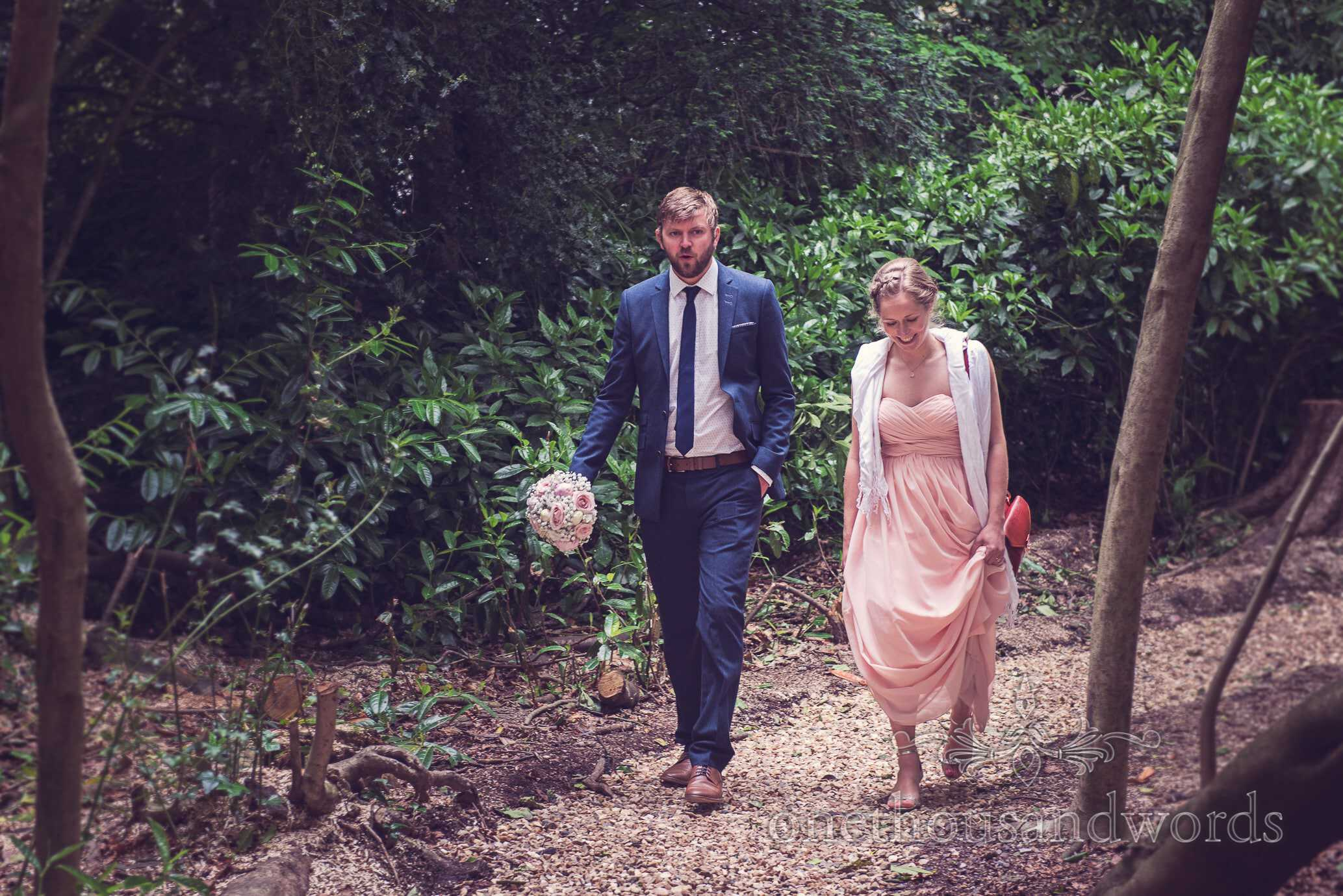 Wedding guest arrive through woodland at Deans Court Wedding Venue