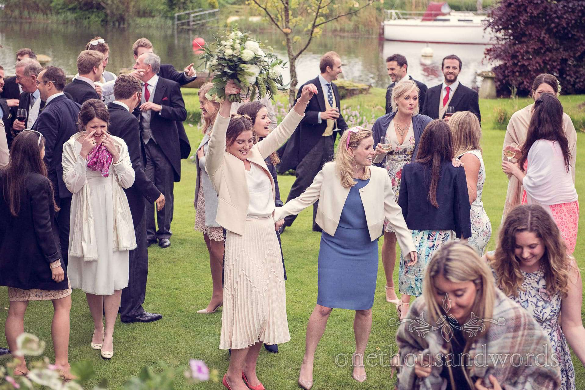 Wedding guest catches the bouquet at The Priory Wareham wedding