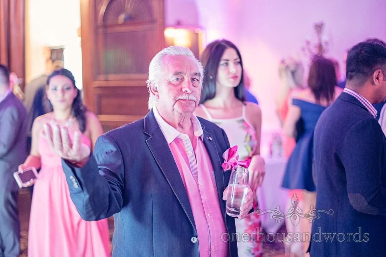 Wedding guest dancing at Rhinefield House Wedding