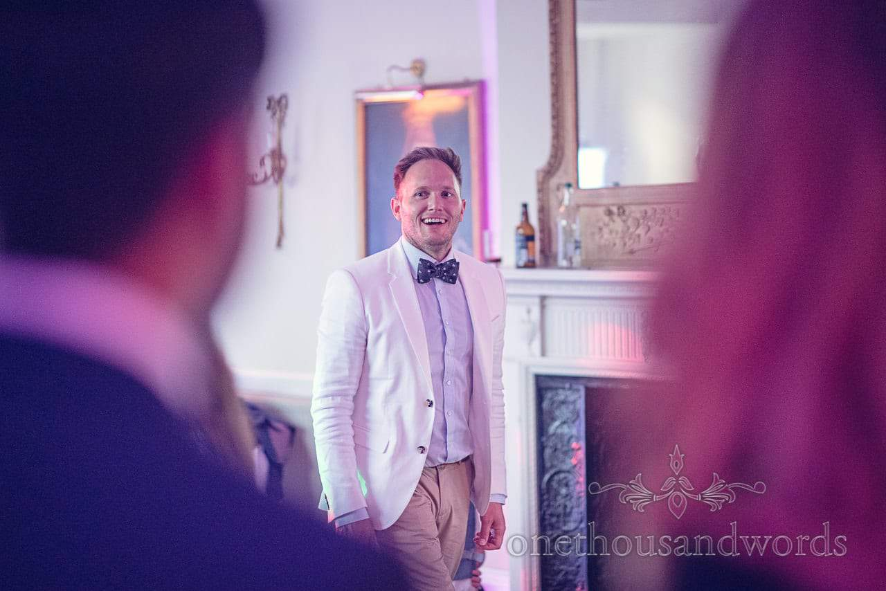 Wedding guest in white suit jacket and bow tie at Rhinefield House Wedding