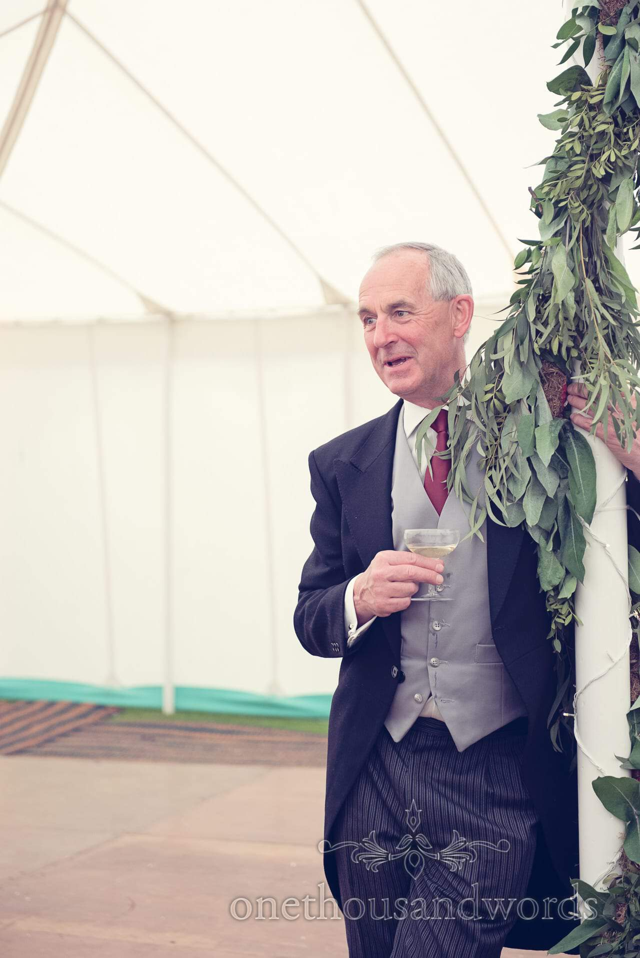 Wedding guest watches speeches at The Priory Wareham wedding