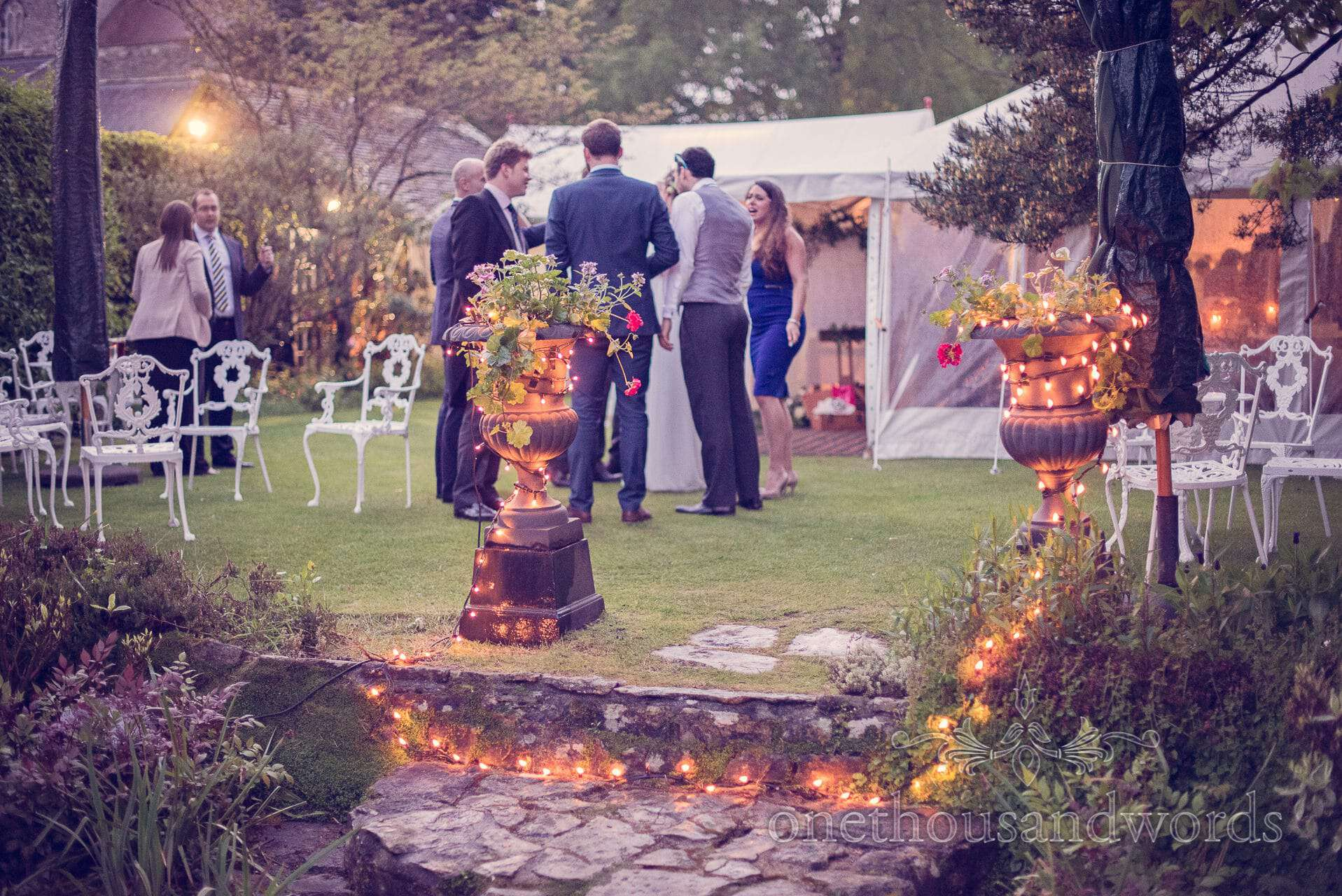 Wedding guests and fairy lights at The Priory Wareham wedding