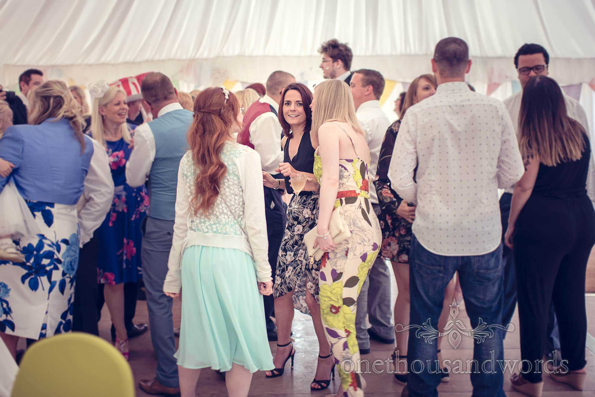 wedding guests dancing in marquee at Deans Court Wedding