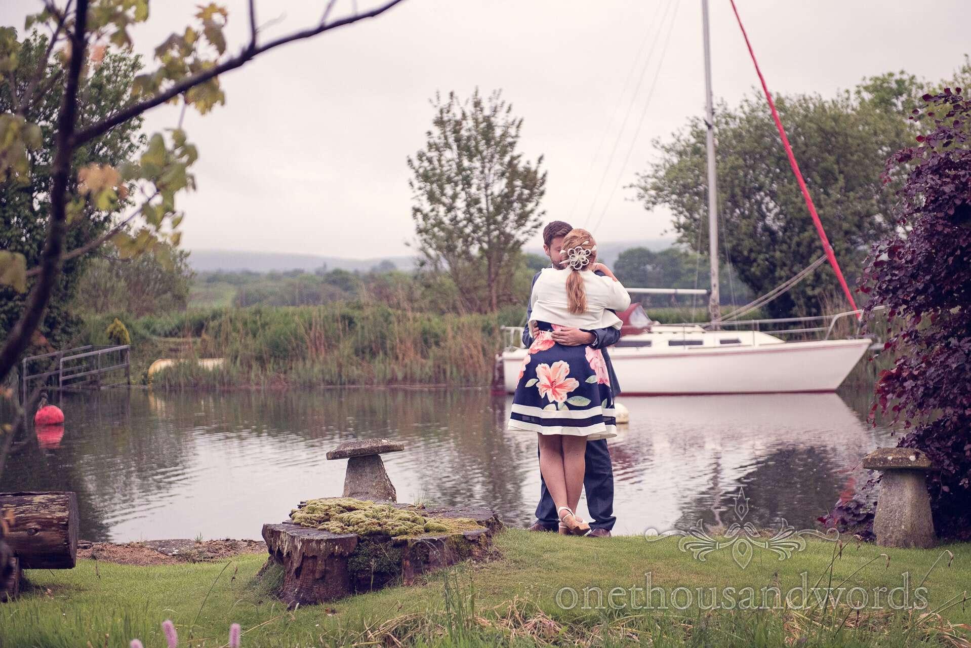 wedding guests hug next to Wareham river