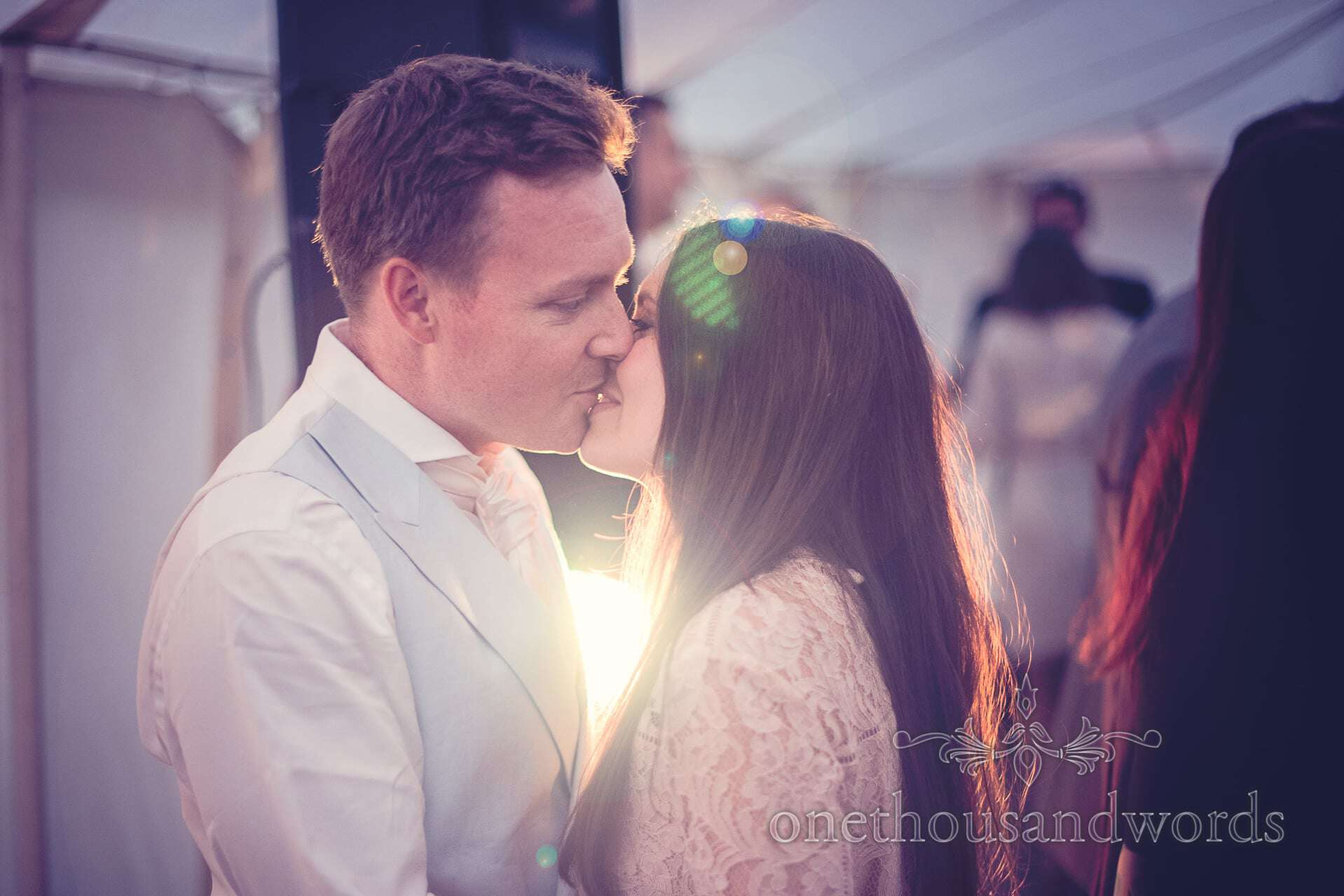 Wedding guests kiss during dancing at The Priory Wareham wedding