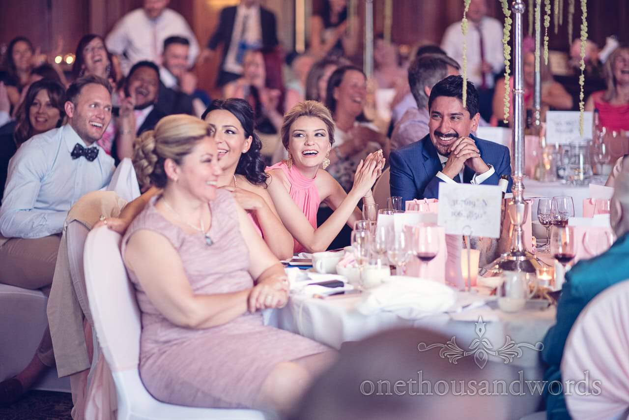 Wedding guests laugh at speeches in Rhienfield House Wedding Photographs