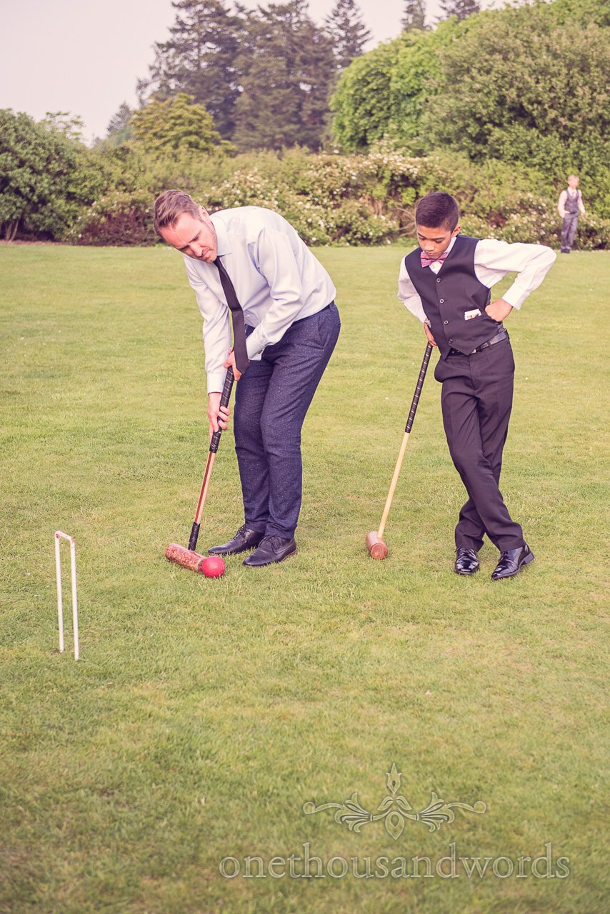 Wedding guests play croquet at Rhinefield House Wedding venue