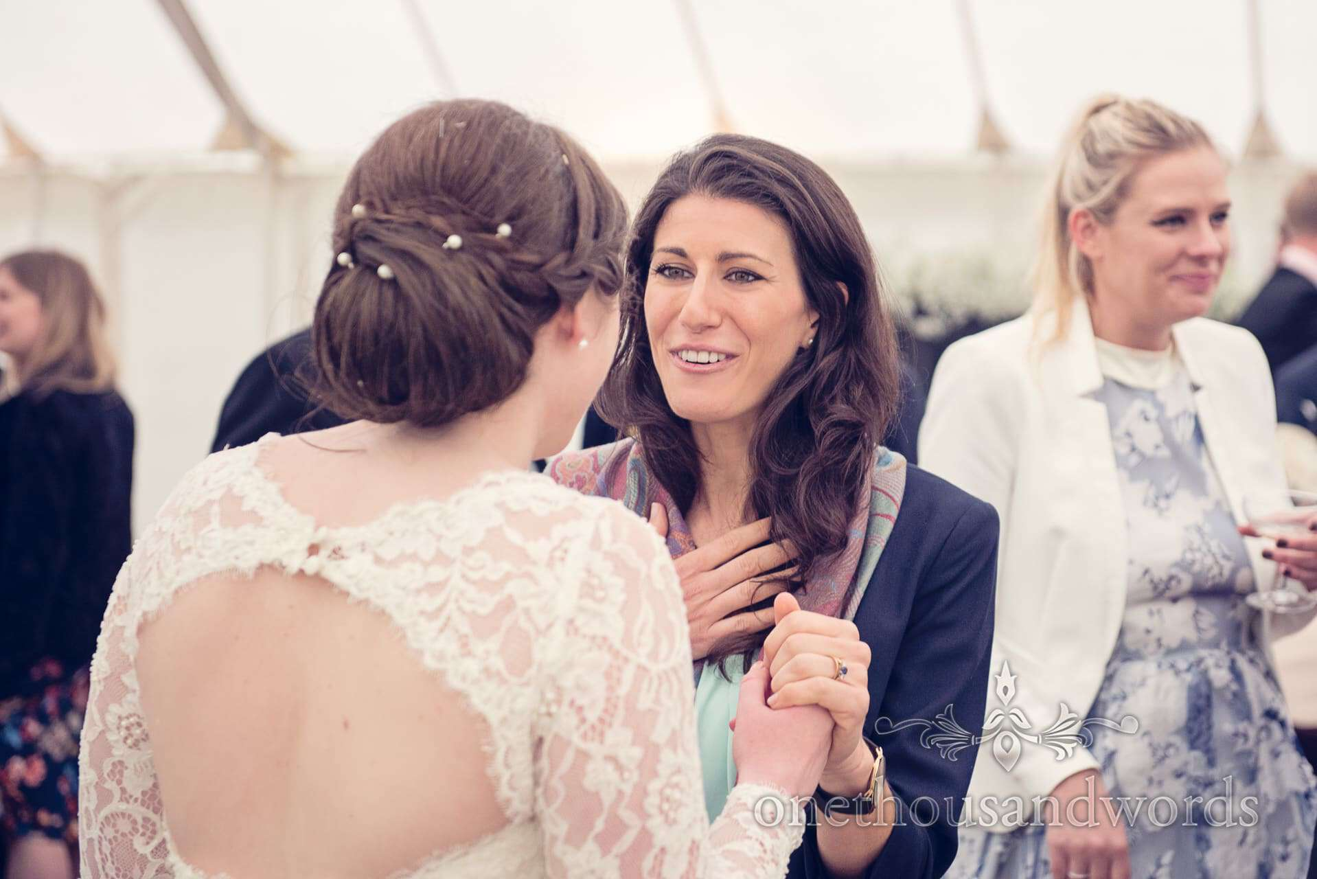 wedding guests talks with bride at The Priory Wareham wedding