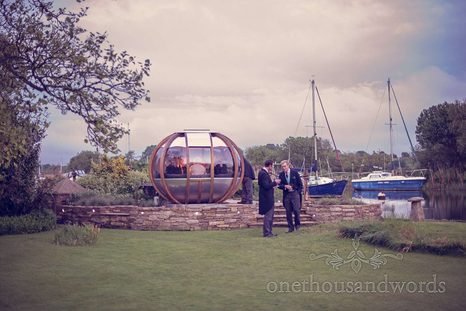 Wedding guests with boats and pod by Wareham River