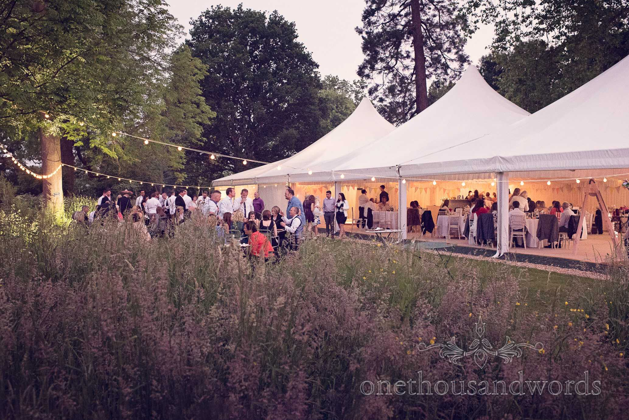 Wedding marquee and garden in the evening with festoon lighting